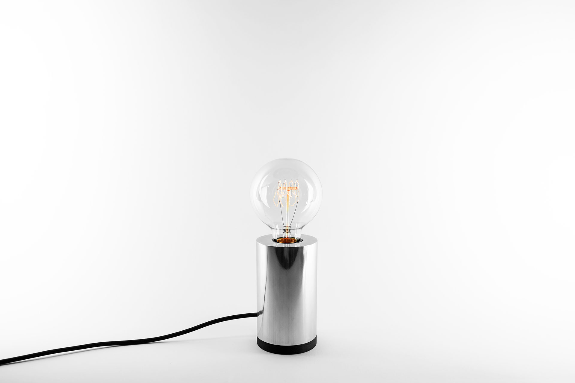 Dimmable bedside lamp in silver color with vinatge Edison bulb inapired by scandinavian design