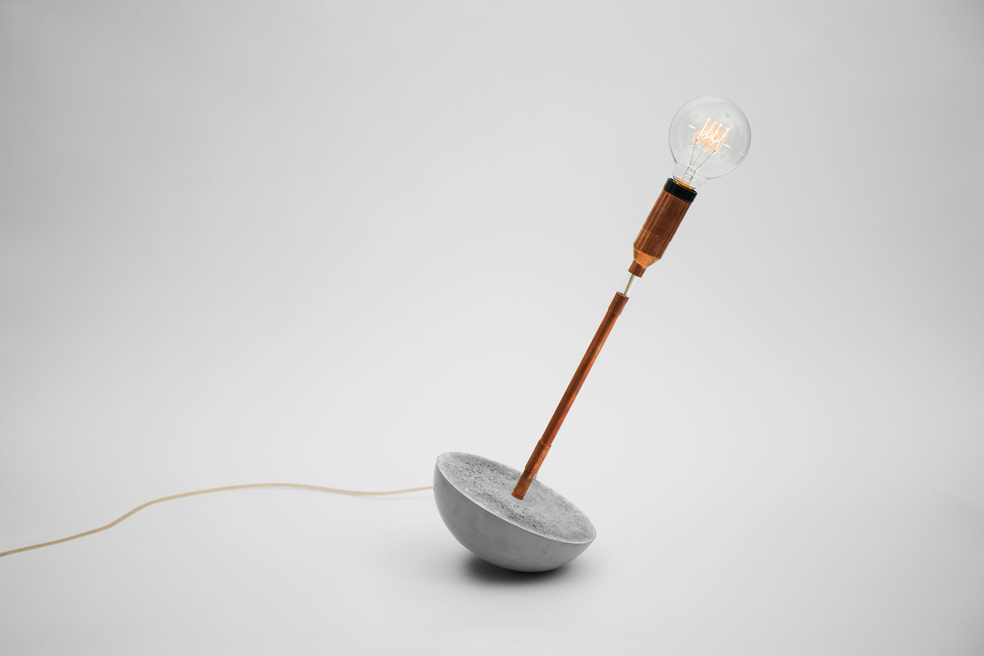 Fun design table lamp with magic touch dimmer and concrete base inspired by soviet era roly-poly toy
