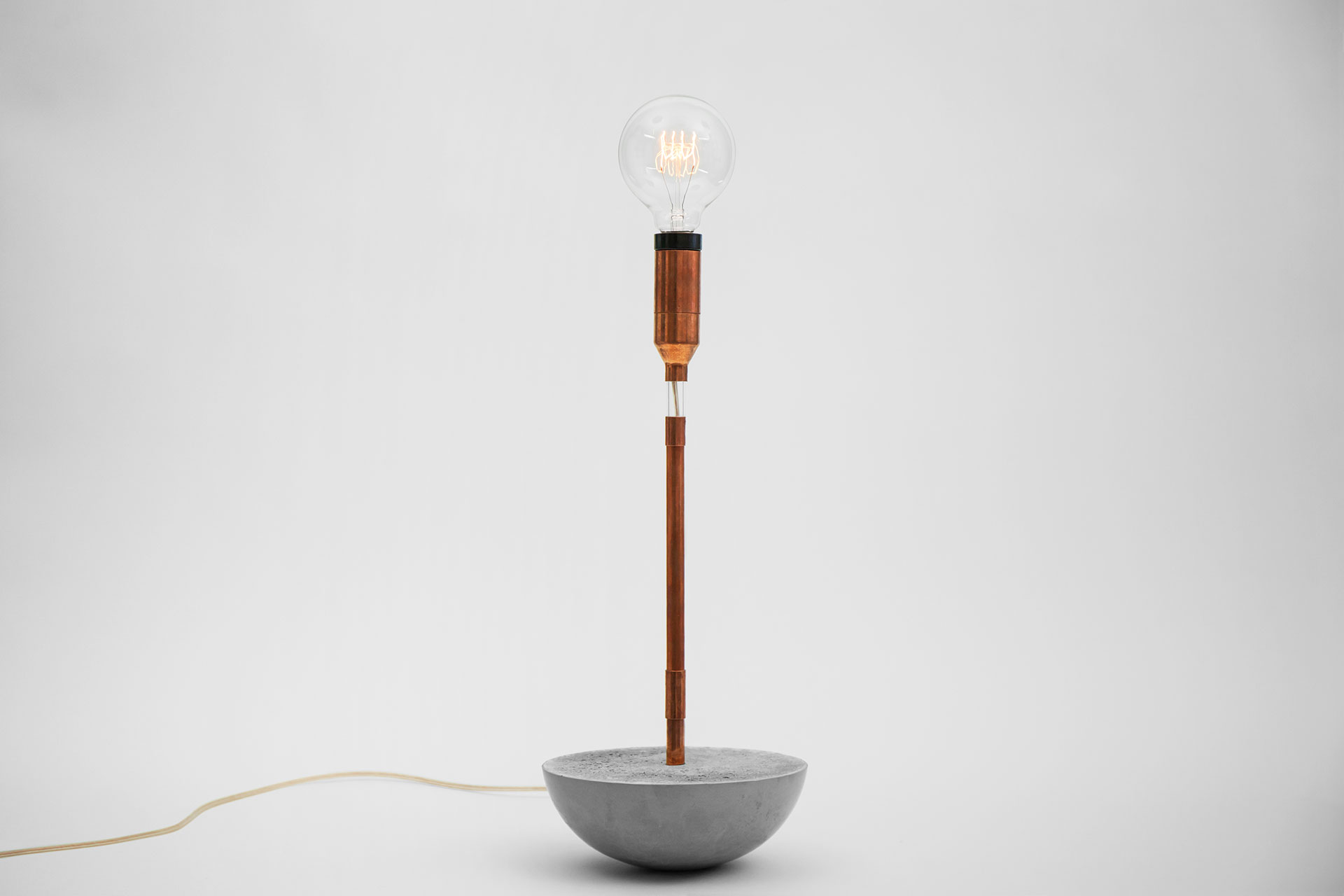 Cool desk lamp made of concrete and copper with magic touch dimmer and vintage Edison bulb