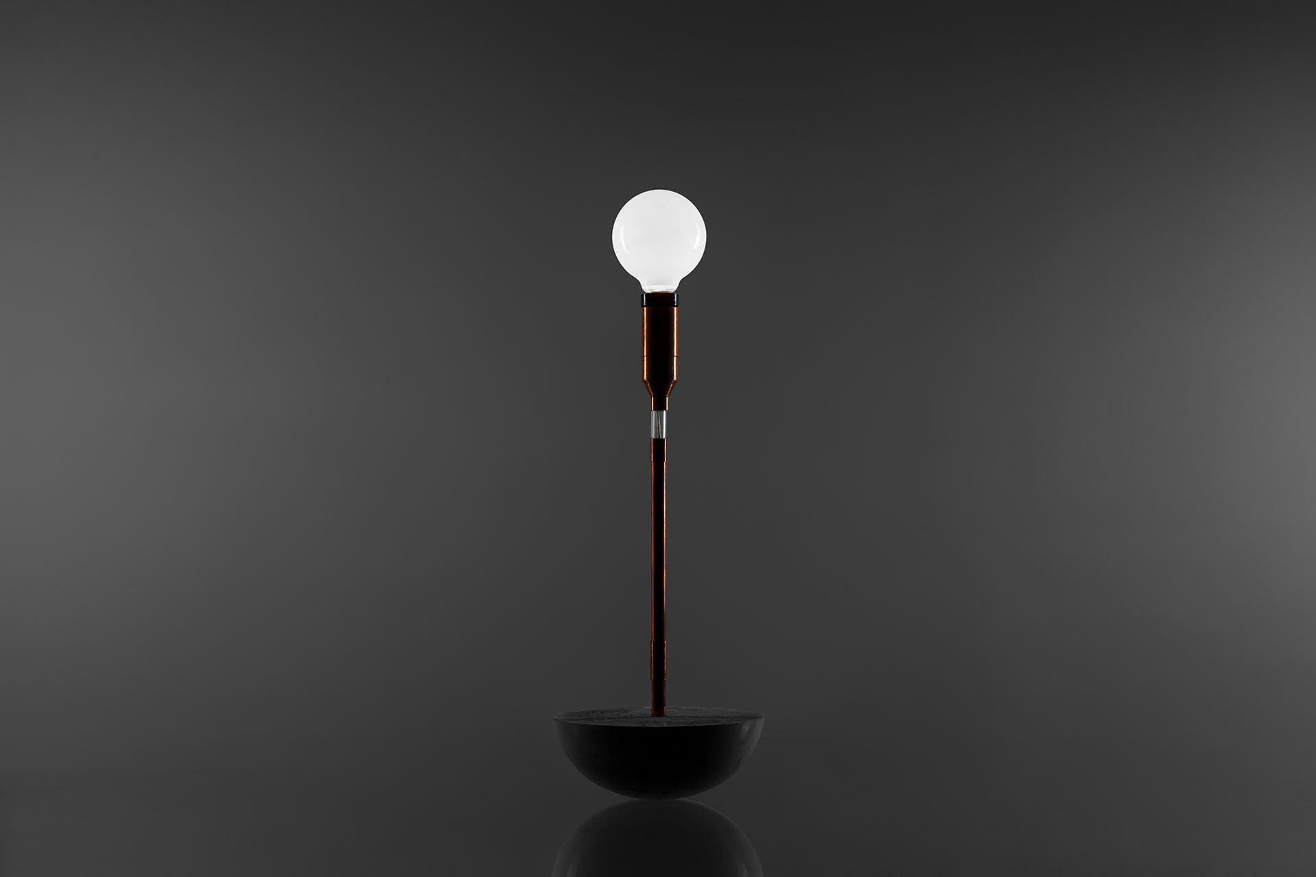 Conceptual desk lamp with magic touch dimmer and concrete base manufactured by european design studio