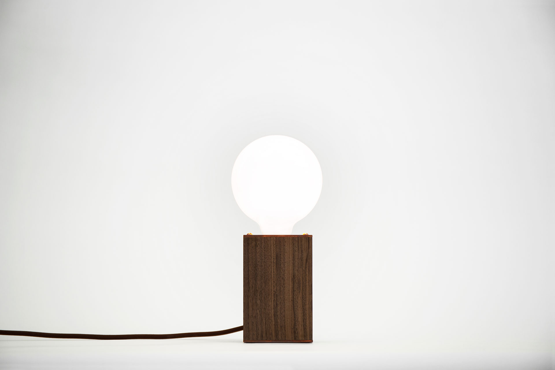 Minimalist desk lamp in solid American walnut and trendy copper with functional touch dimmer inspired by danish design