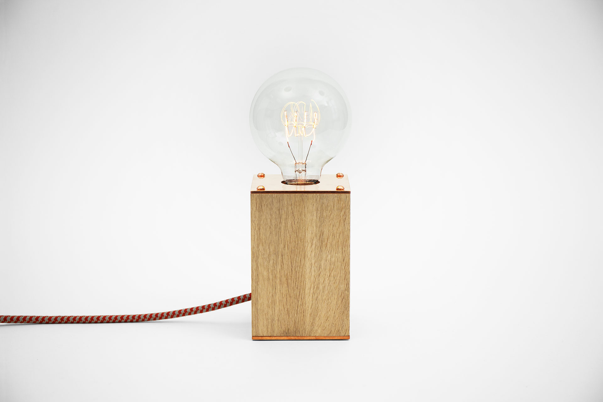 Small dimmable table lamp in natural oak and trendy copper with vintage Edison bulb inspired by loft design