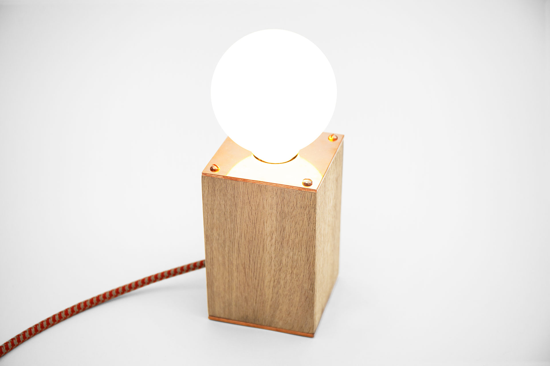 Wooden table lamp with trendy copper details and creative touch dimmer in cozy chic bedroom