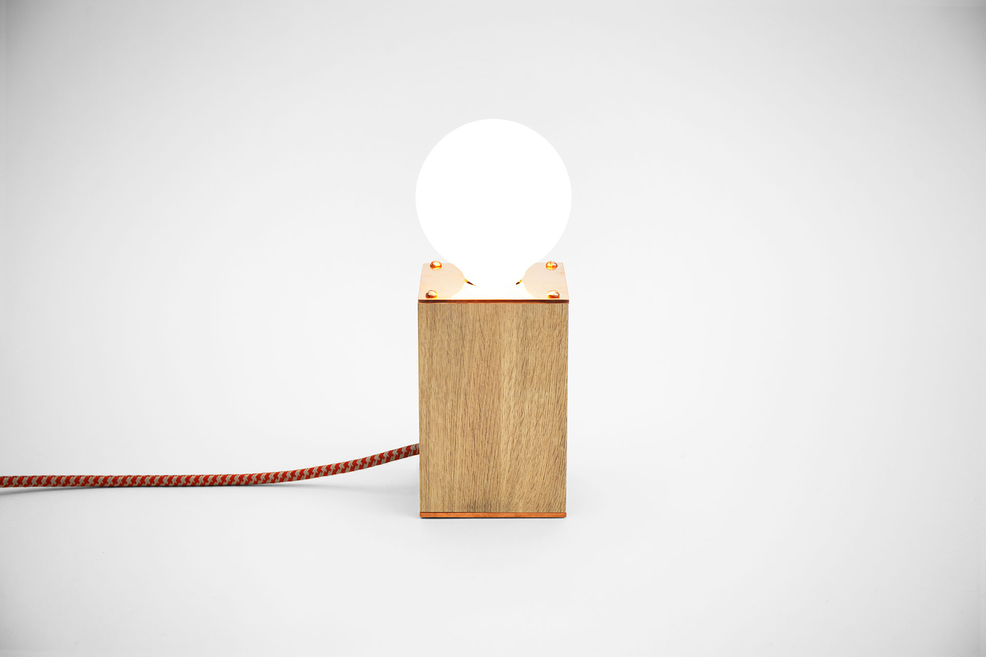 Simple bedside lamp in oak wood and fashionable copper with functional touch dimmer inspired by scandinavian design