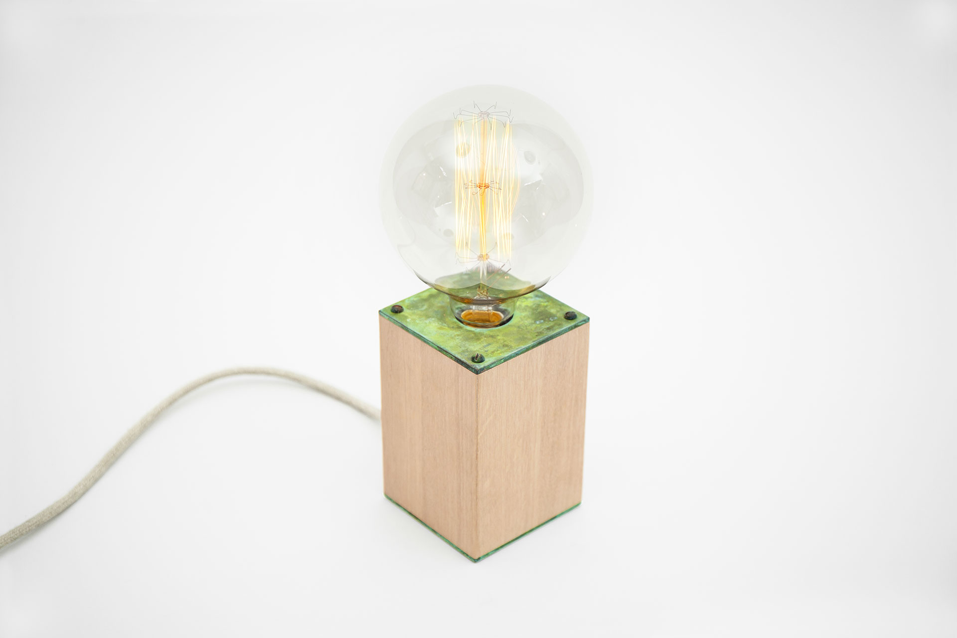 Colorful table lamp in natural oak wood and handmade green patina with magic touch dimmer and large retro bulb