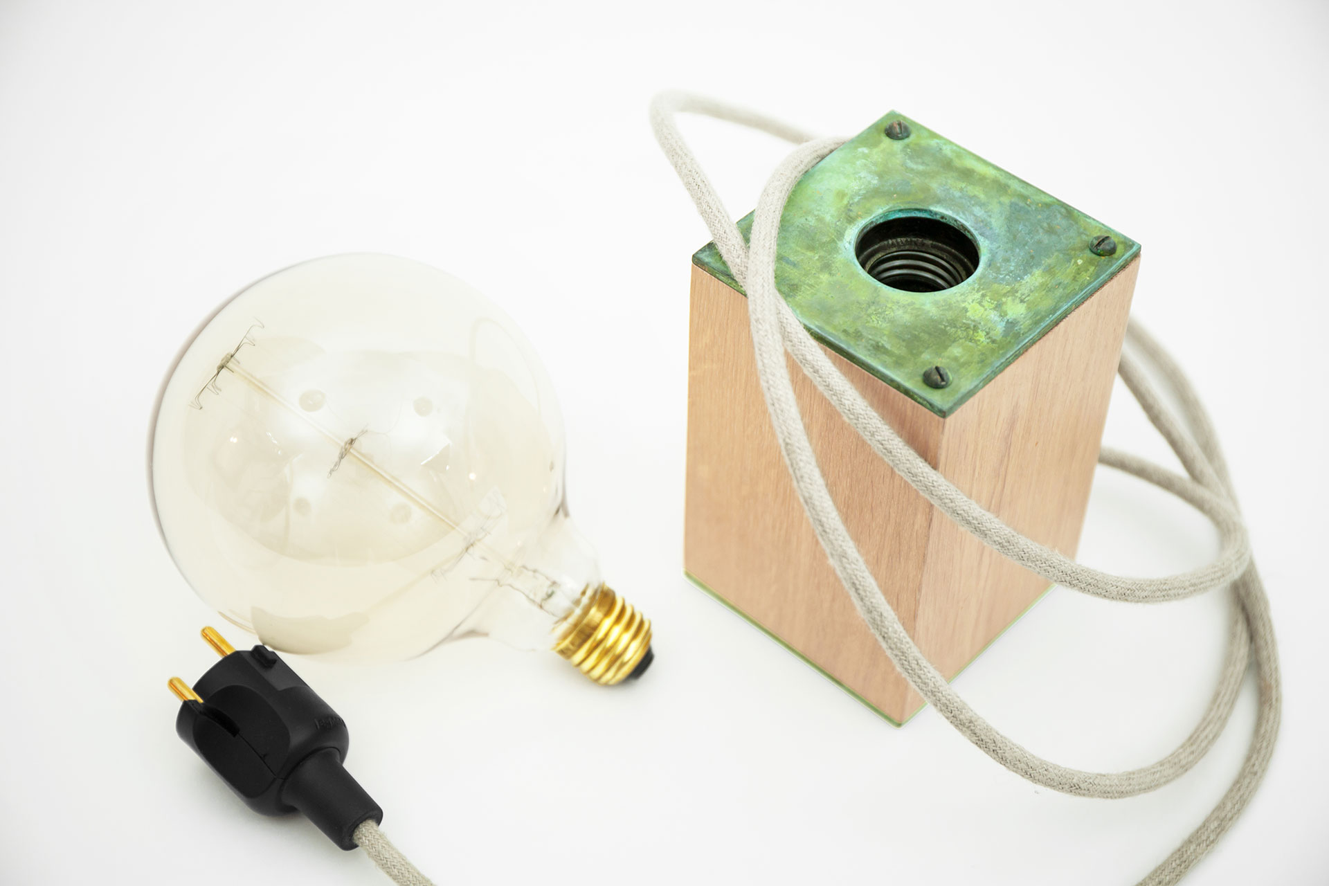 Wooden bedside lamp with natural green patina and built-in touch dimmer manufactured by european design studio