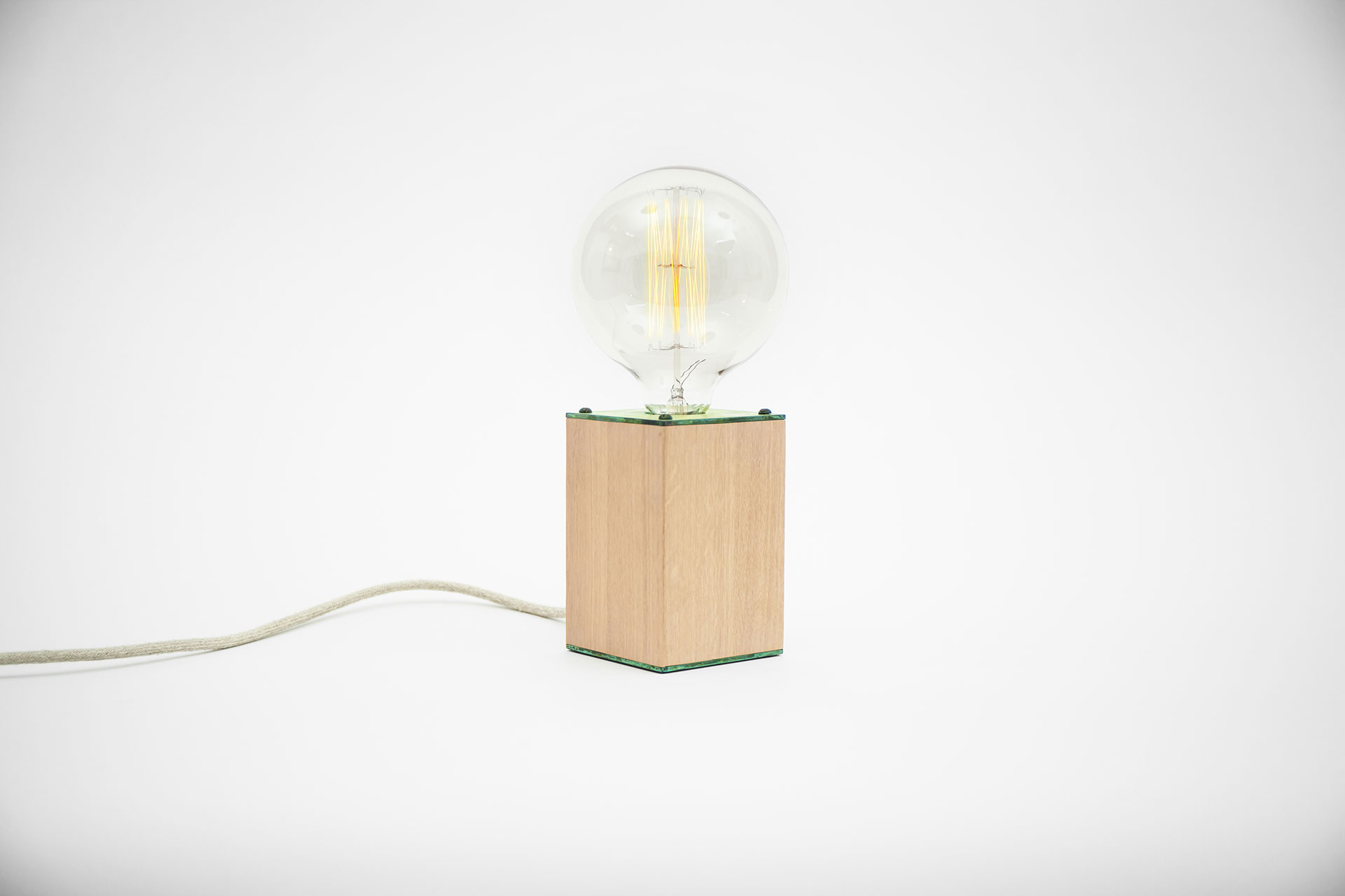 Scandinavian design bedside lamp in natural oak wood and fashionable green patina with touch dimmer and retro bulb