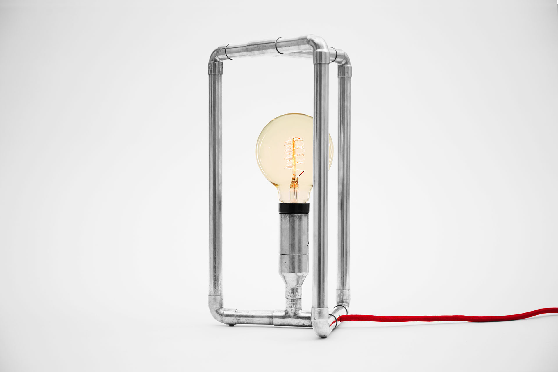 Fun design table lamp in silver nickel plated metal finish with cool touch dimmer inspired by industrial style