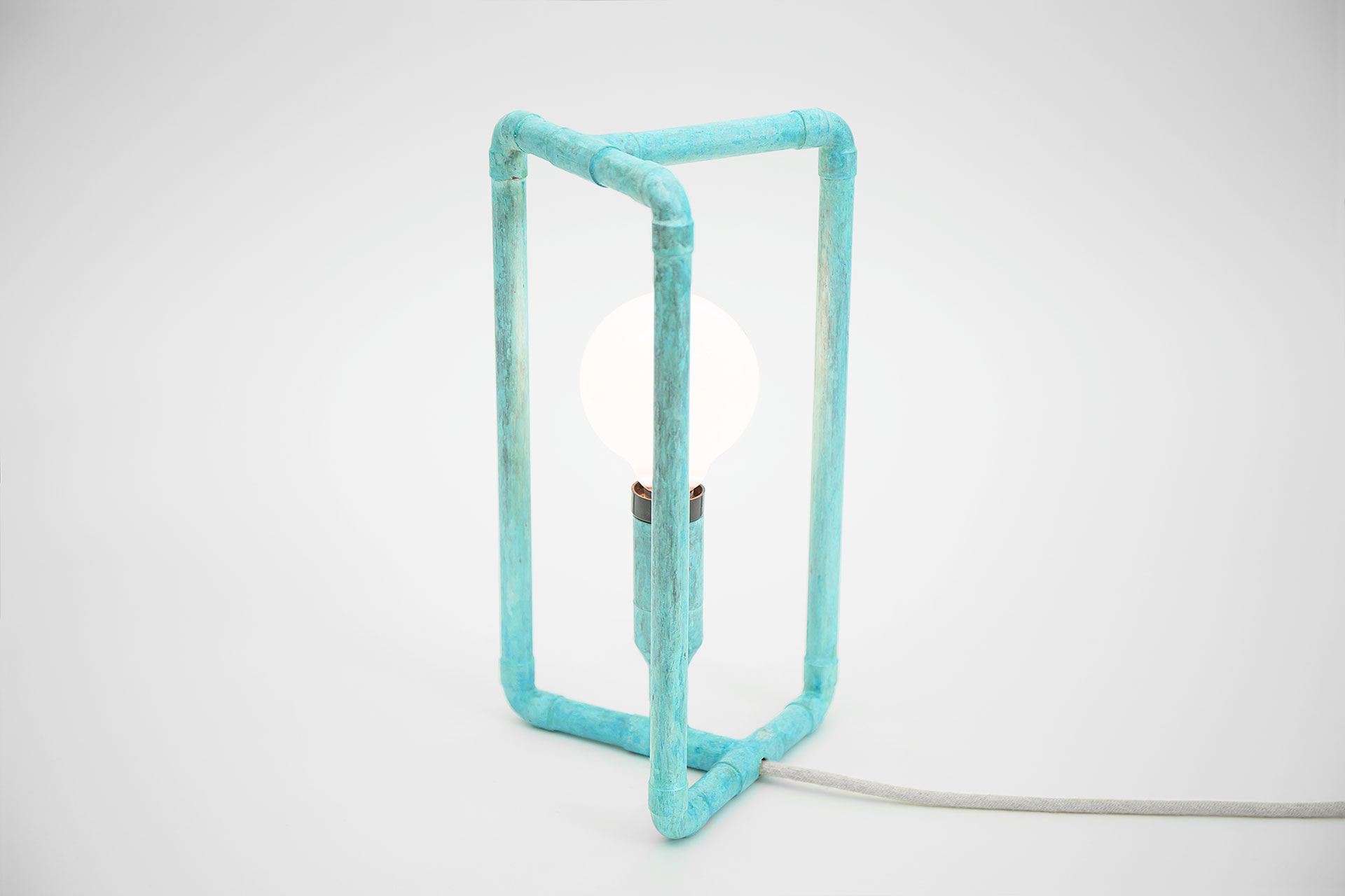 Cozy bedside lamp in trendy turquoise patina with creative touch dimmer inspired by scandinavian design