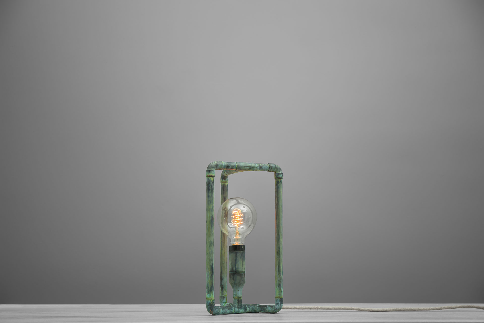 Loft style desk lamp in natural green patina with creative touch dimmer and vintage Edison bulb