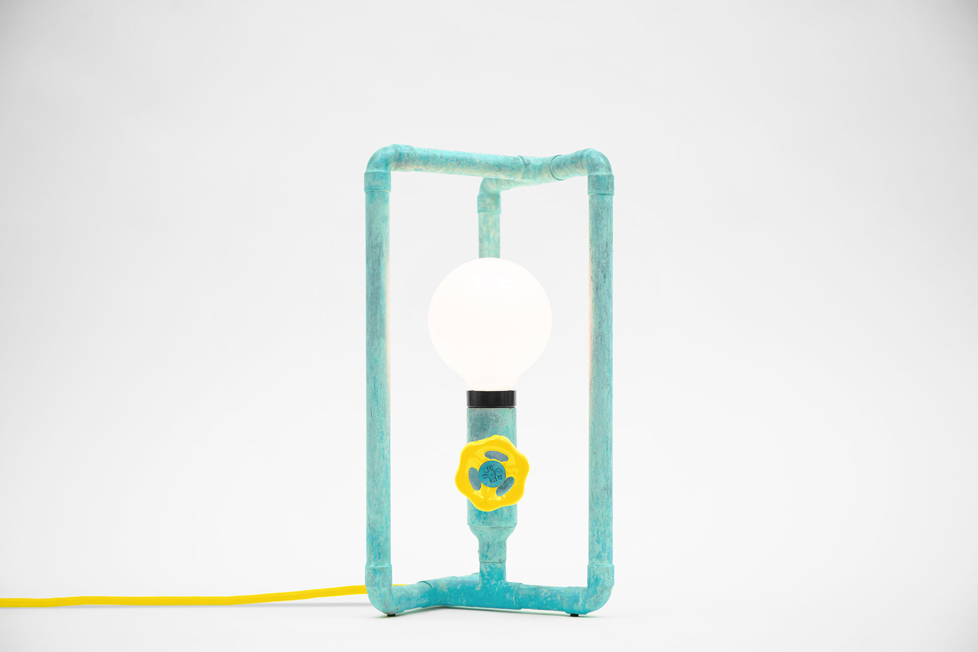 Cozy bedside lamp in joyful turquoise color with yellow knob dimmer and yellow braided cord