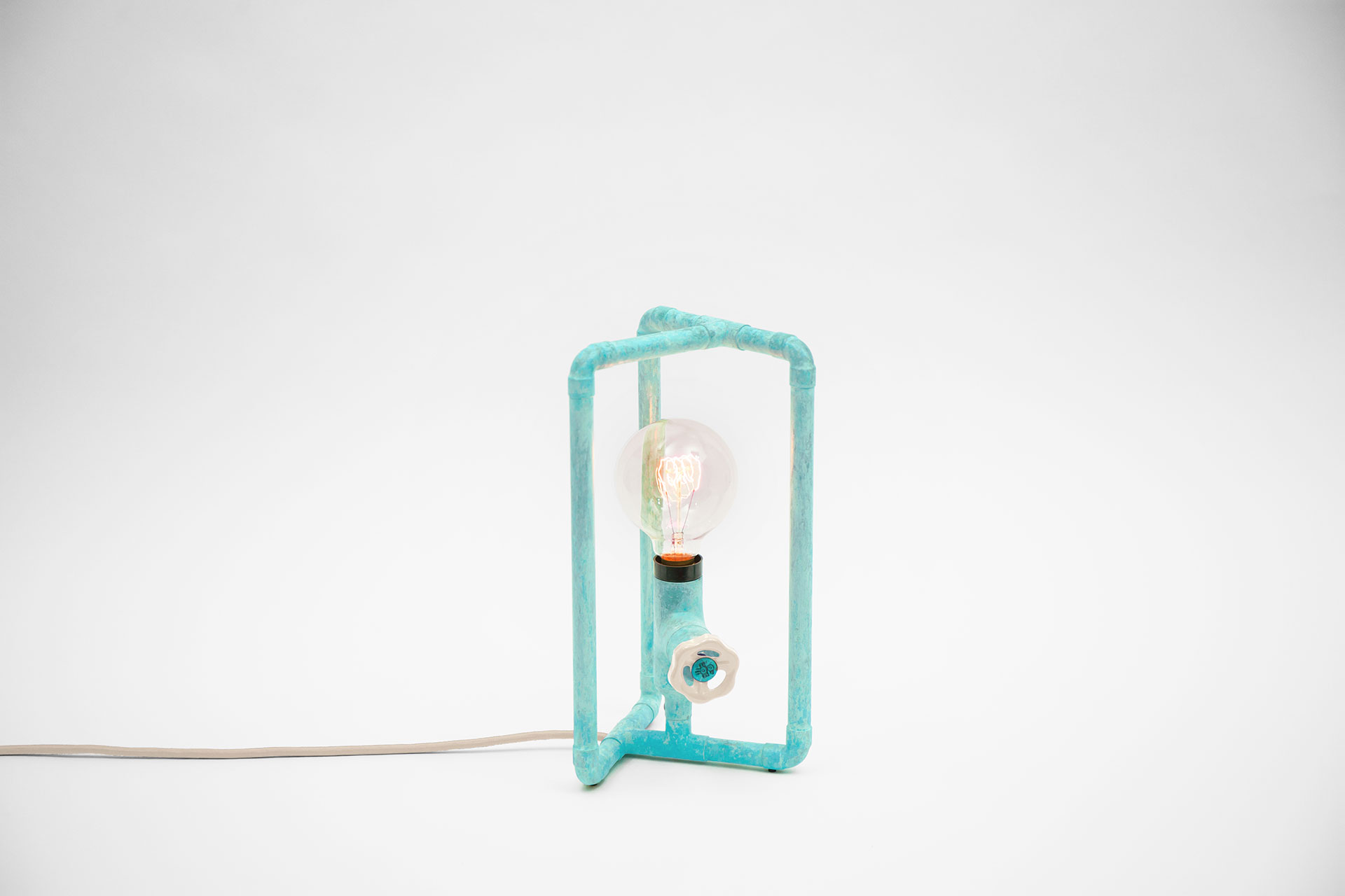 Scandinavian bedside lamp in trendy turquoise color with ivory knob dimmer and retro bulb