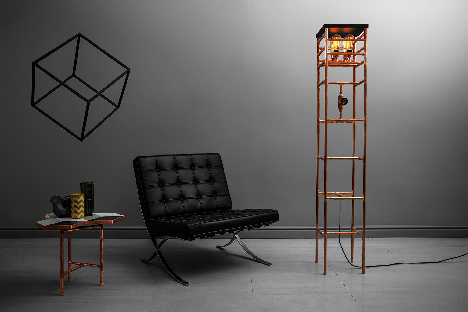 Copper side table in modern men's apartment