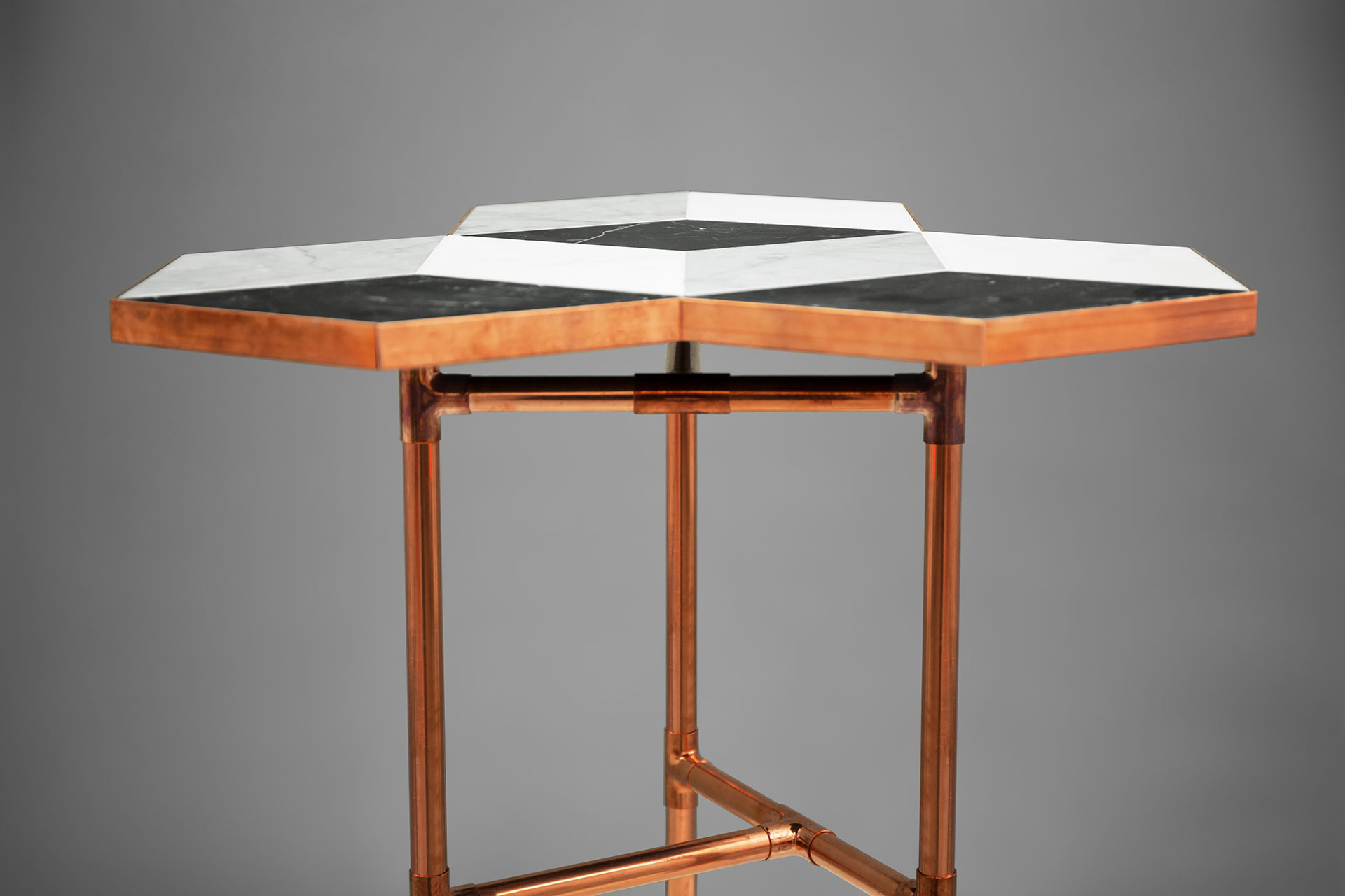 Artistic coffee table from copper and marble