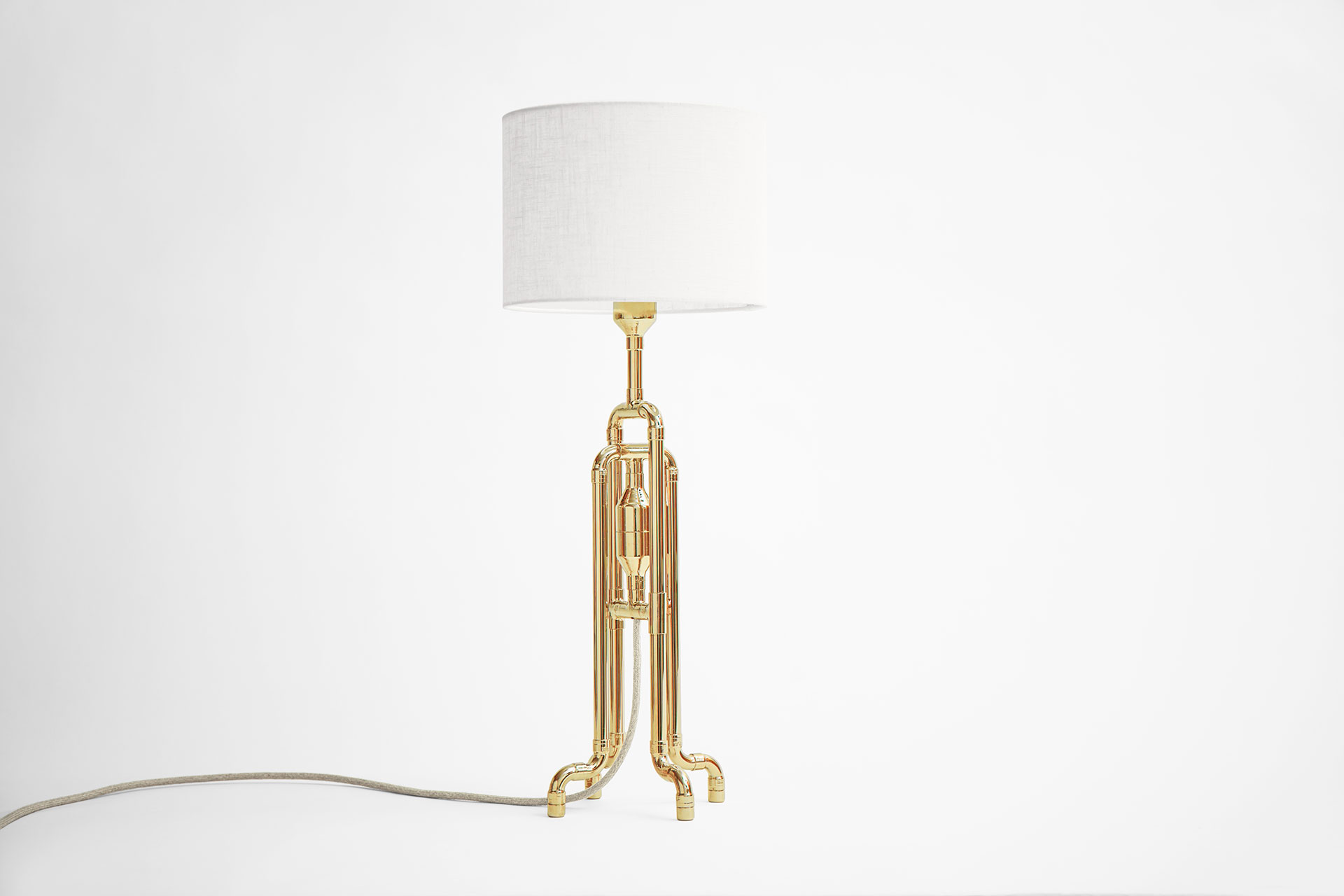 Designer table lamp in gold brass metal finish with white natural linen shade inspired by jellyfish shape