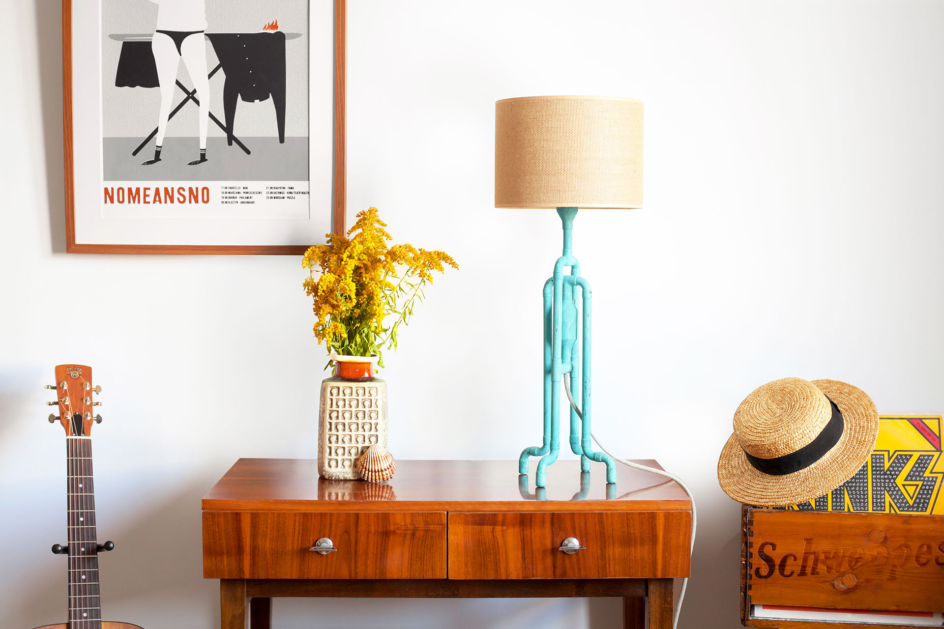 Cozy table lamp in trendy turquoise color with natural jute shade in vintage modern apartment