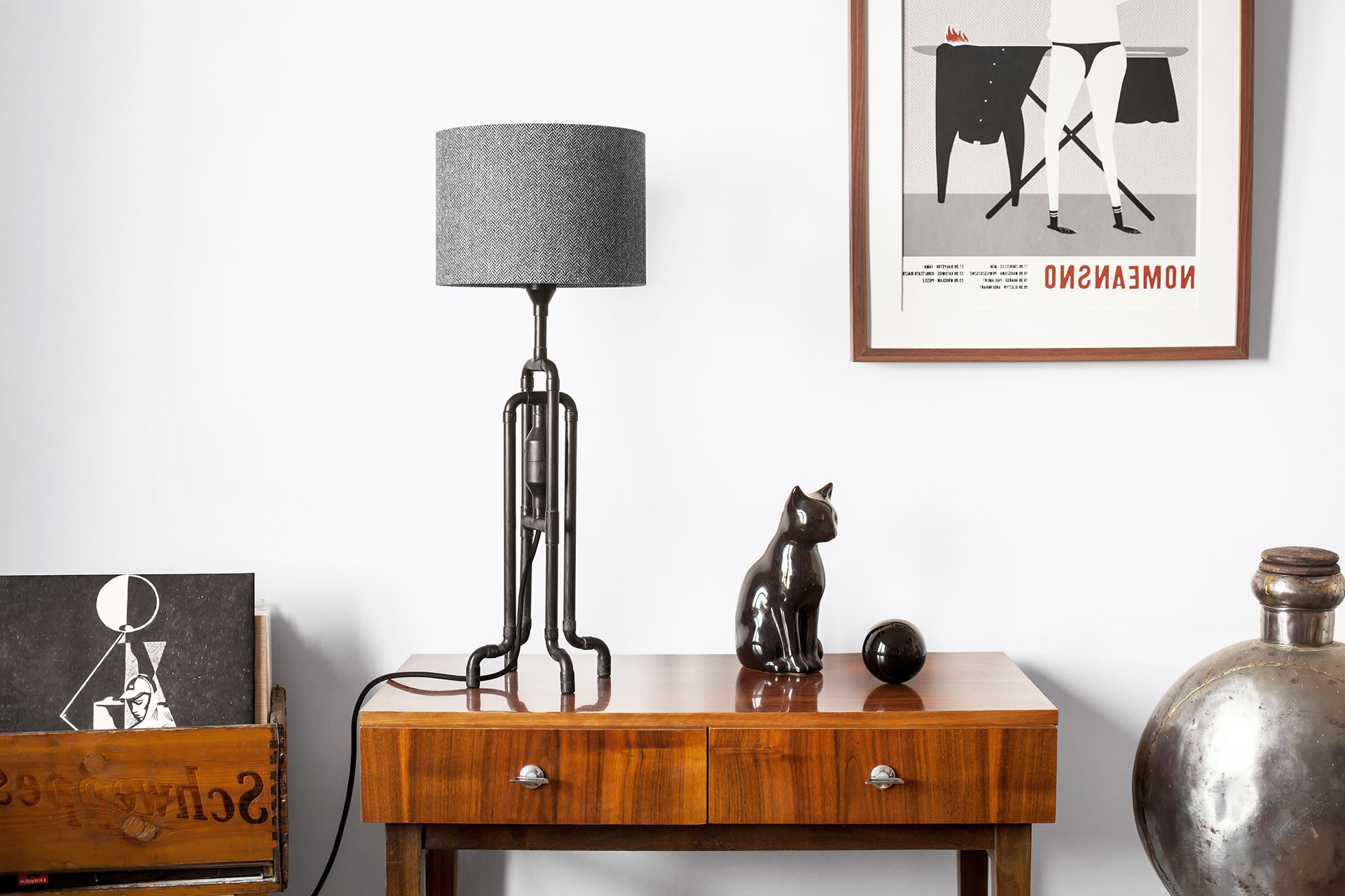 Industrial design table lamp in natural black patina with custom tweed shade in mid-century modern apartment