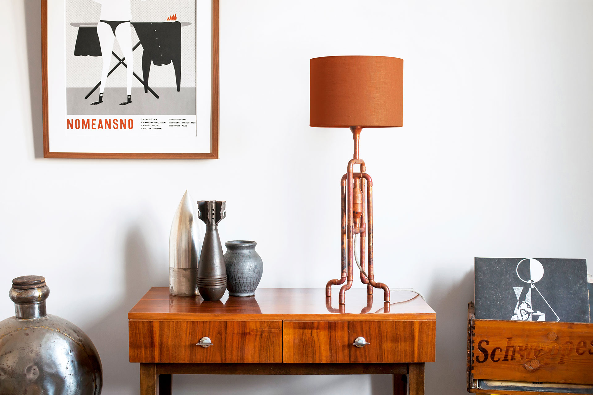 Rust metal table lamp with copper color linen shade in vintage modern apartment