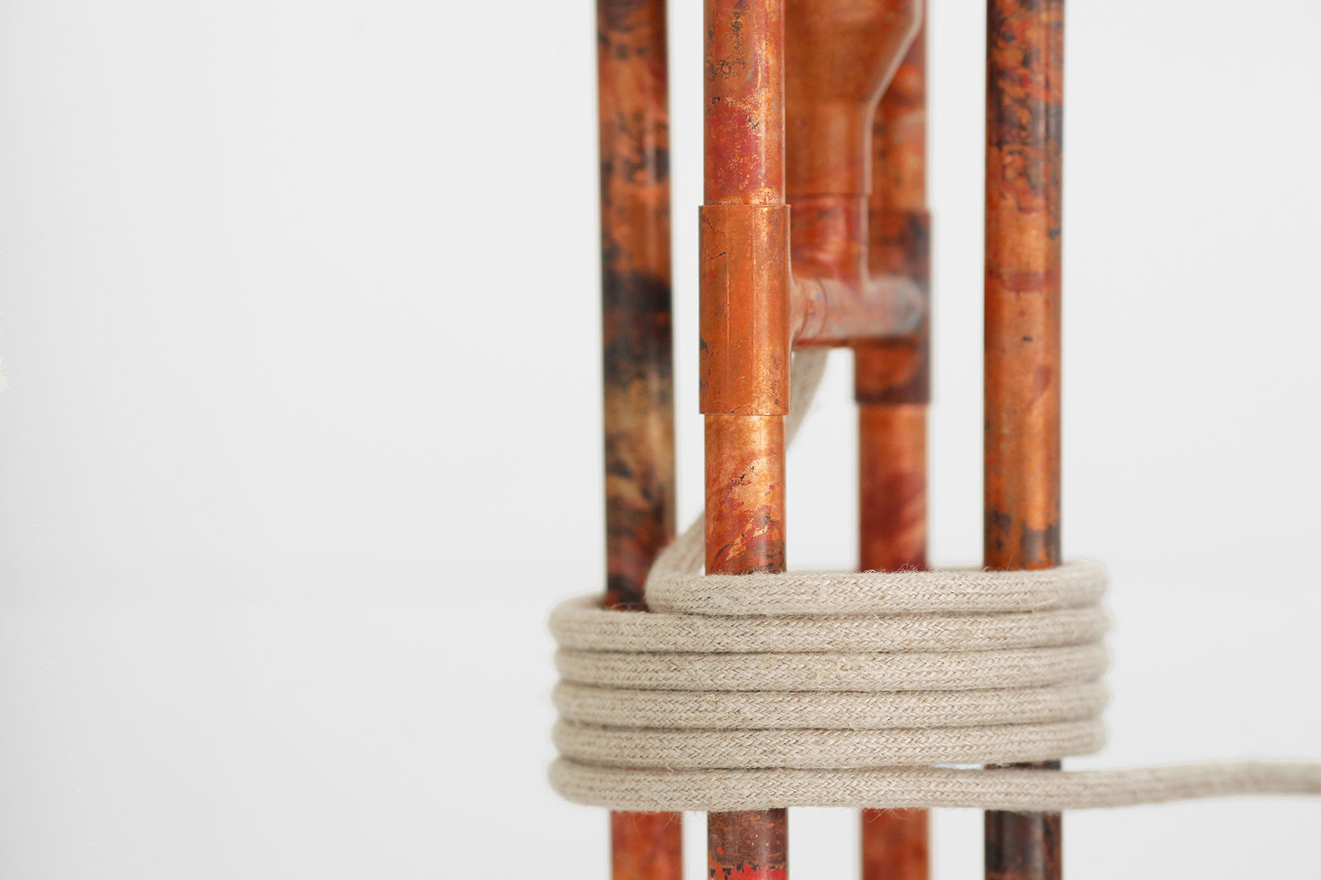 Designer table lamp in aged copper patina