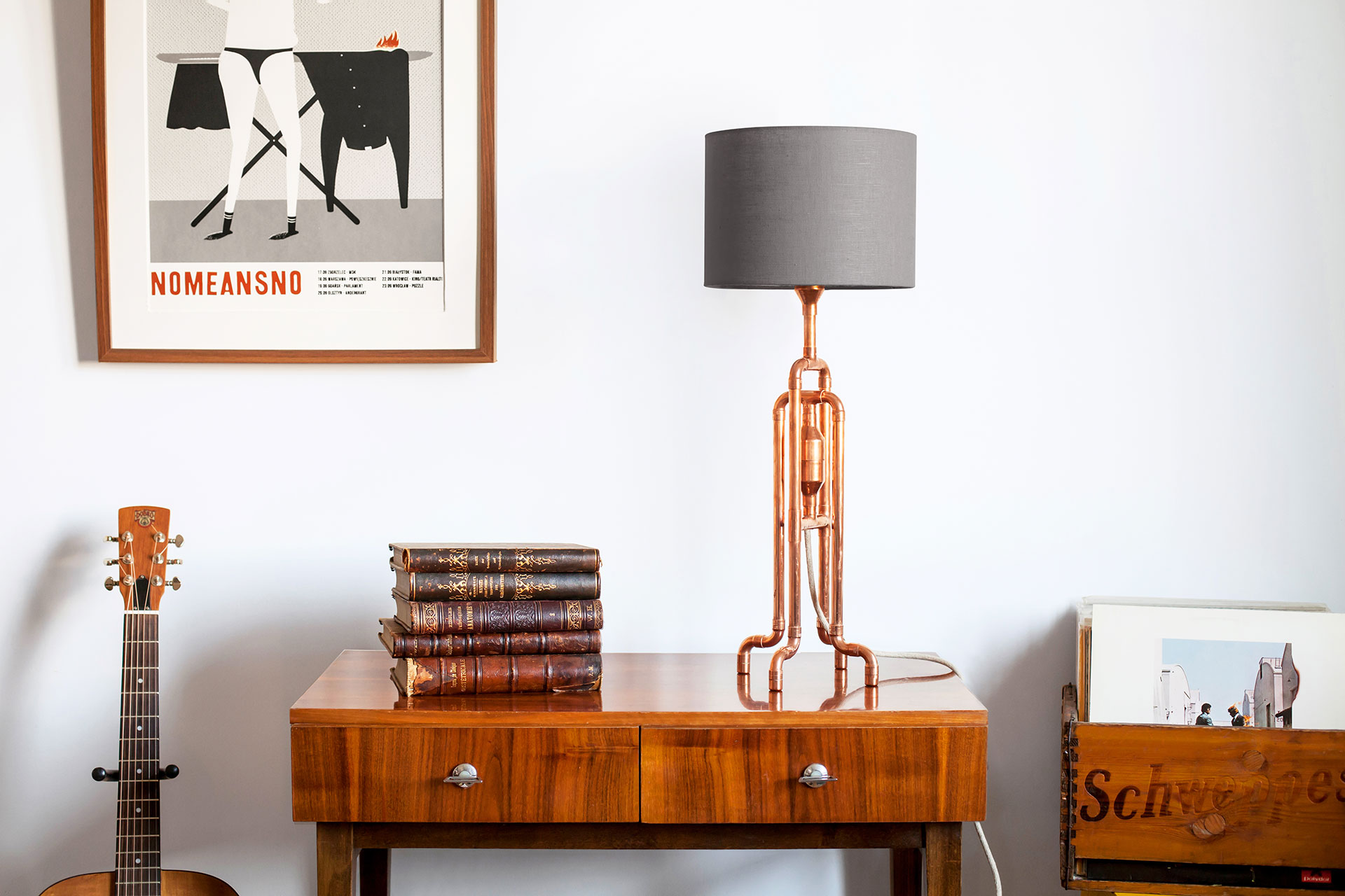 Copper tubing console lamp with grey linen shade inspired by industrial design in hipster apartment