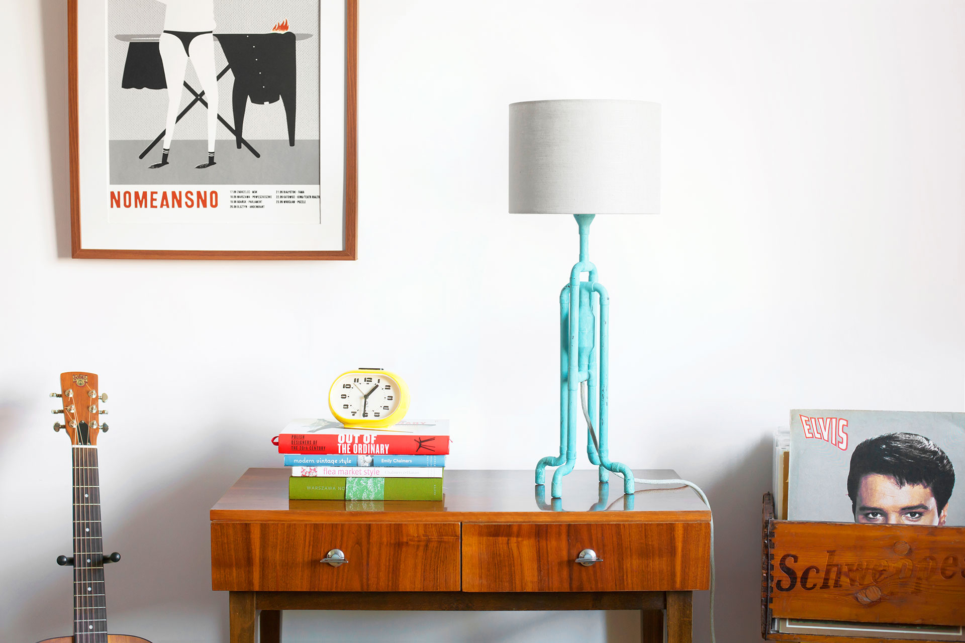 Unique console lamp in trendy turquoise patina with natural linen shade in colorful mid-century modern apartment