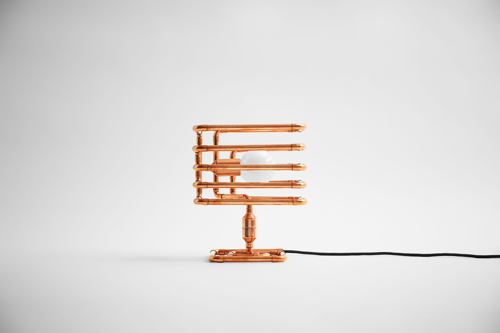 Unusual table lamp in trendy copper metal finish inspired by industrial design