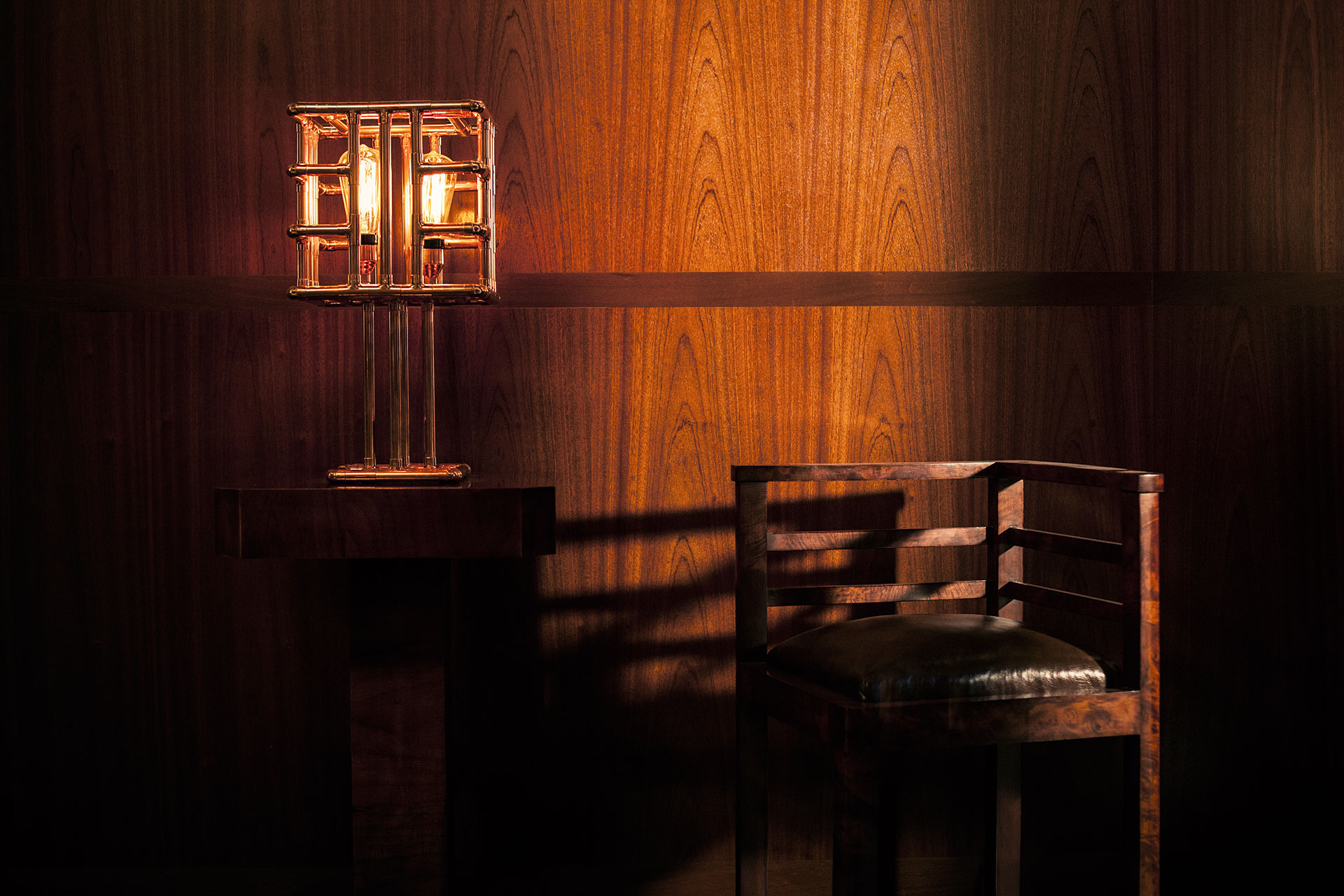 Decorative table lamp in trendy copper metal finish inspired by Art Deco design