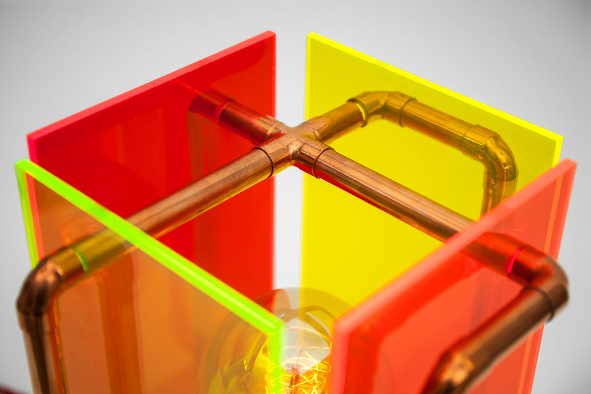 Designer lighting tabel lamp in colorful plexiglas and copper pipes inspired by modern fun art