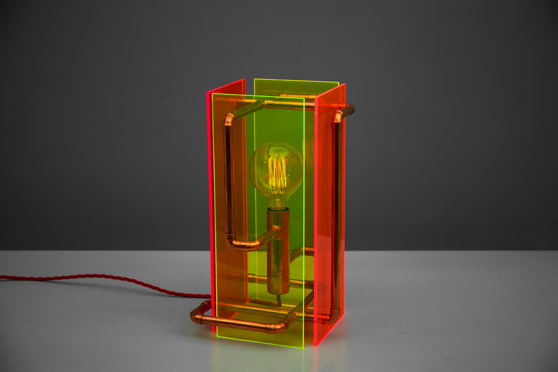 Contemporary ighting design made of fluorescent plexiglass and copper pipes with touch dimmer