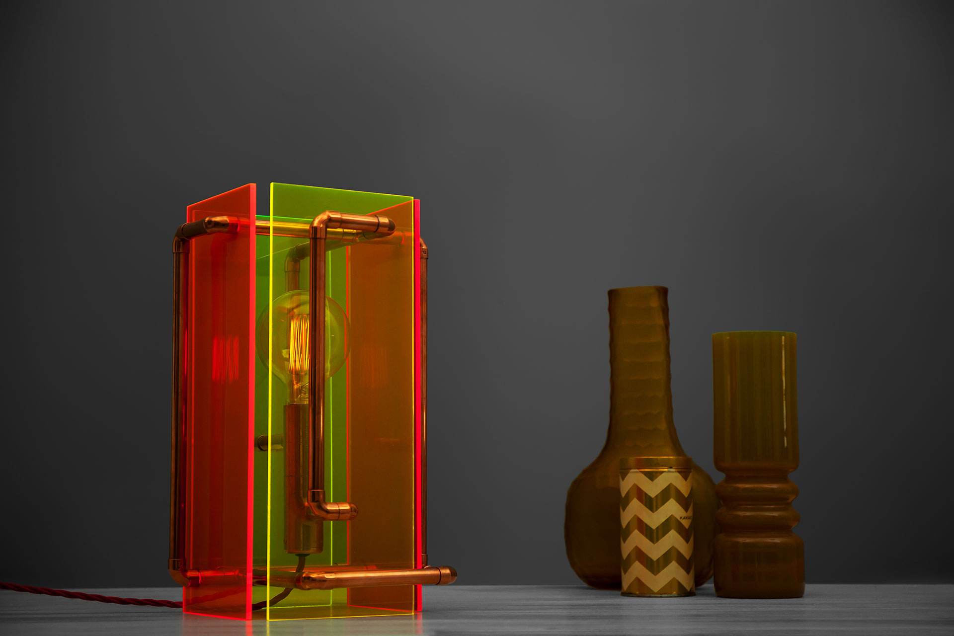 Sculpture table lamp inspired by 80's colorful plastic design and modern industrial style