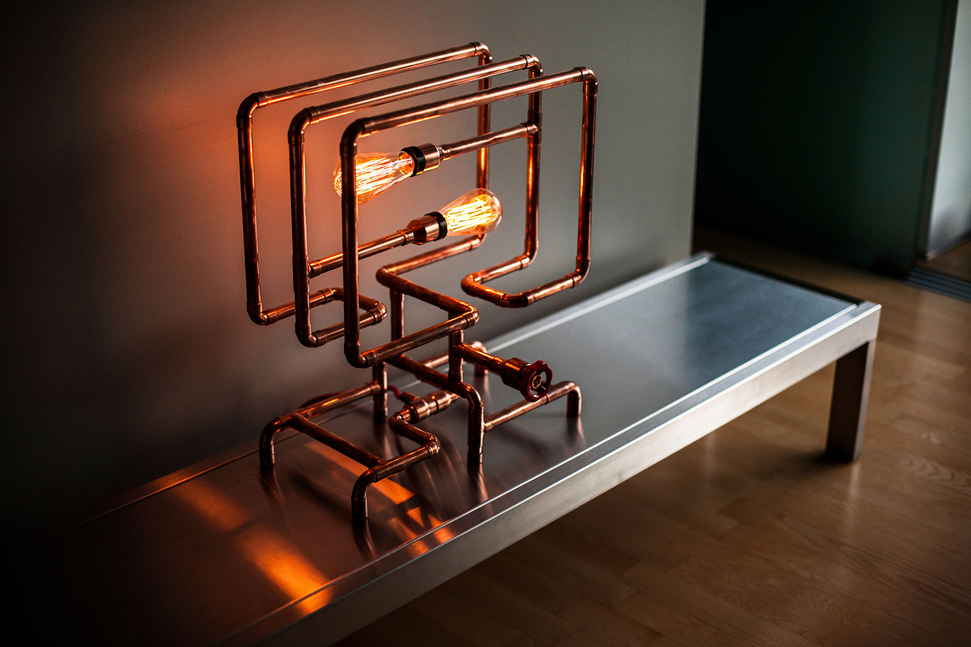 Industrial design copper table lamp with retro Edison bulbs in modern men's apartment