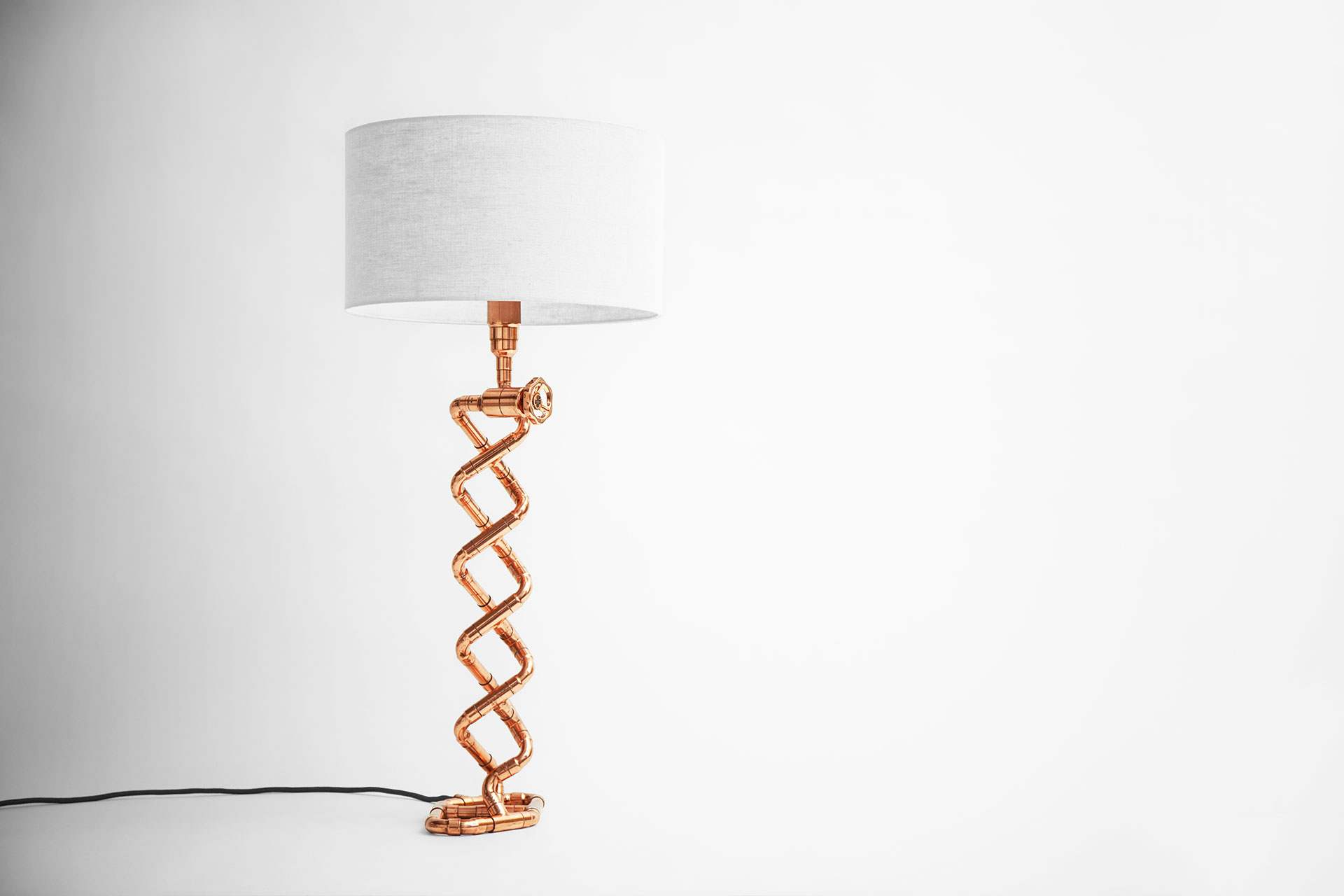Designer table lamp in trendy copper finish with dimmer and linen shade inspired by DNA double helix