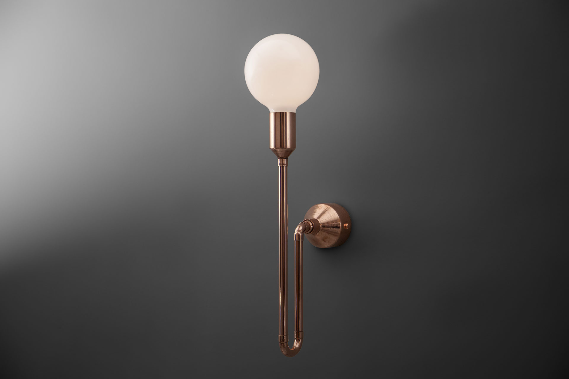 Copper pipe wall lamp inspired by industrial design