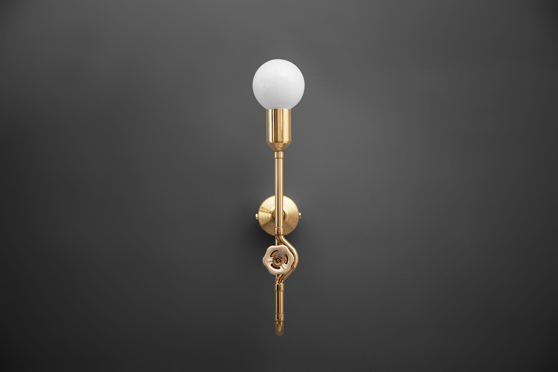 Brass dimmable sconce with vintage ivory knob