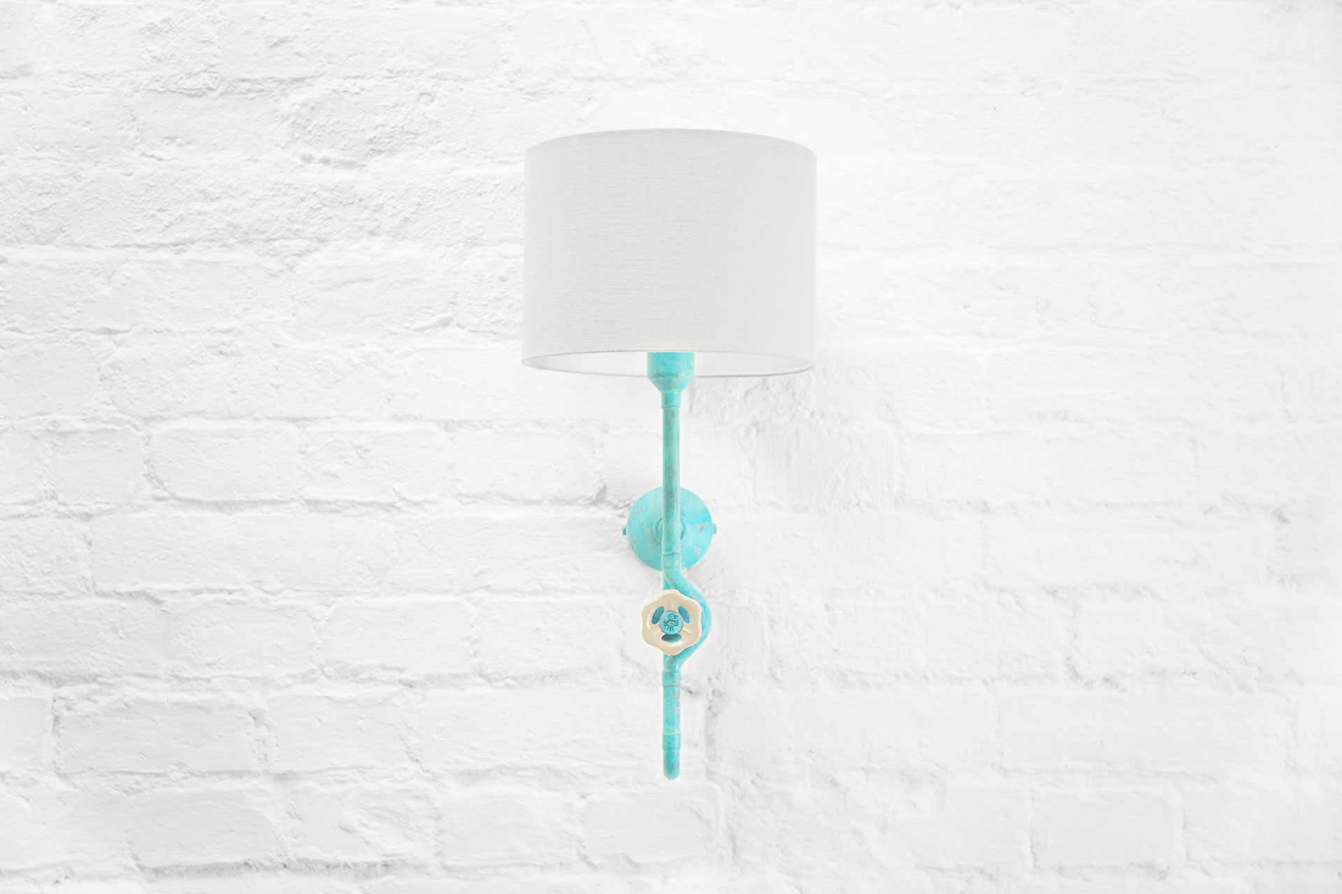 Unique turquoise sconce in cozy design aparment