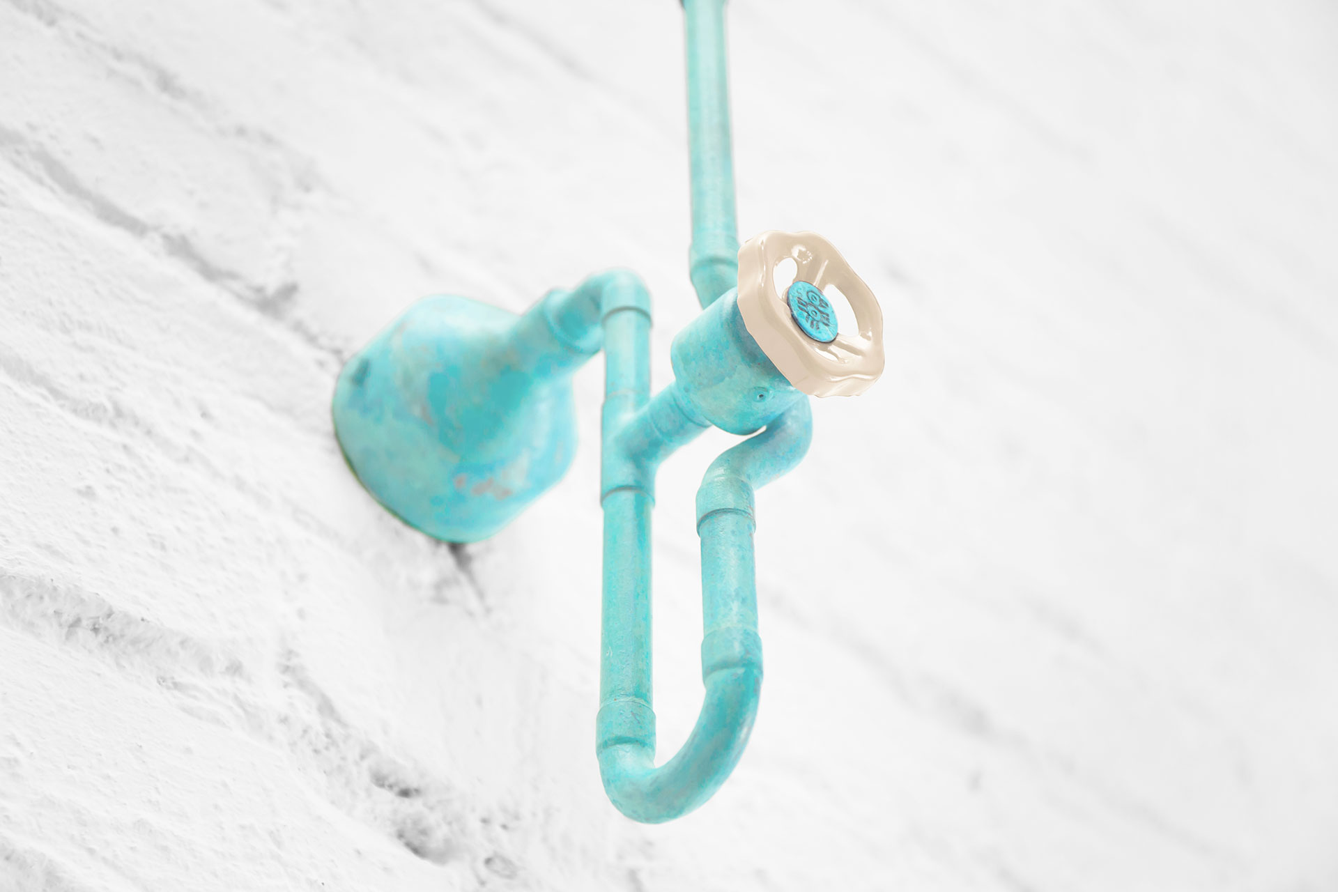 Cool dimmable sconce in turquoise patina inspired by industrial design