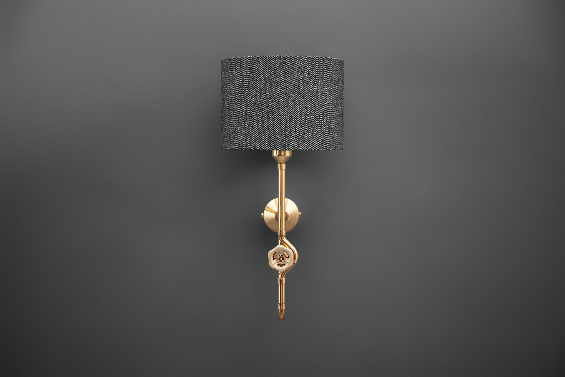 Designers sconce with tweed shade and knob dimmer