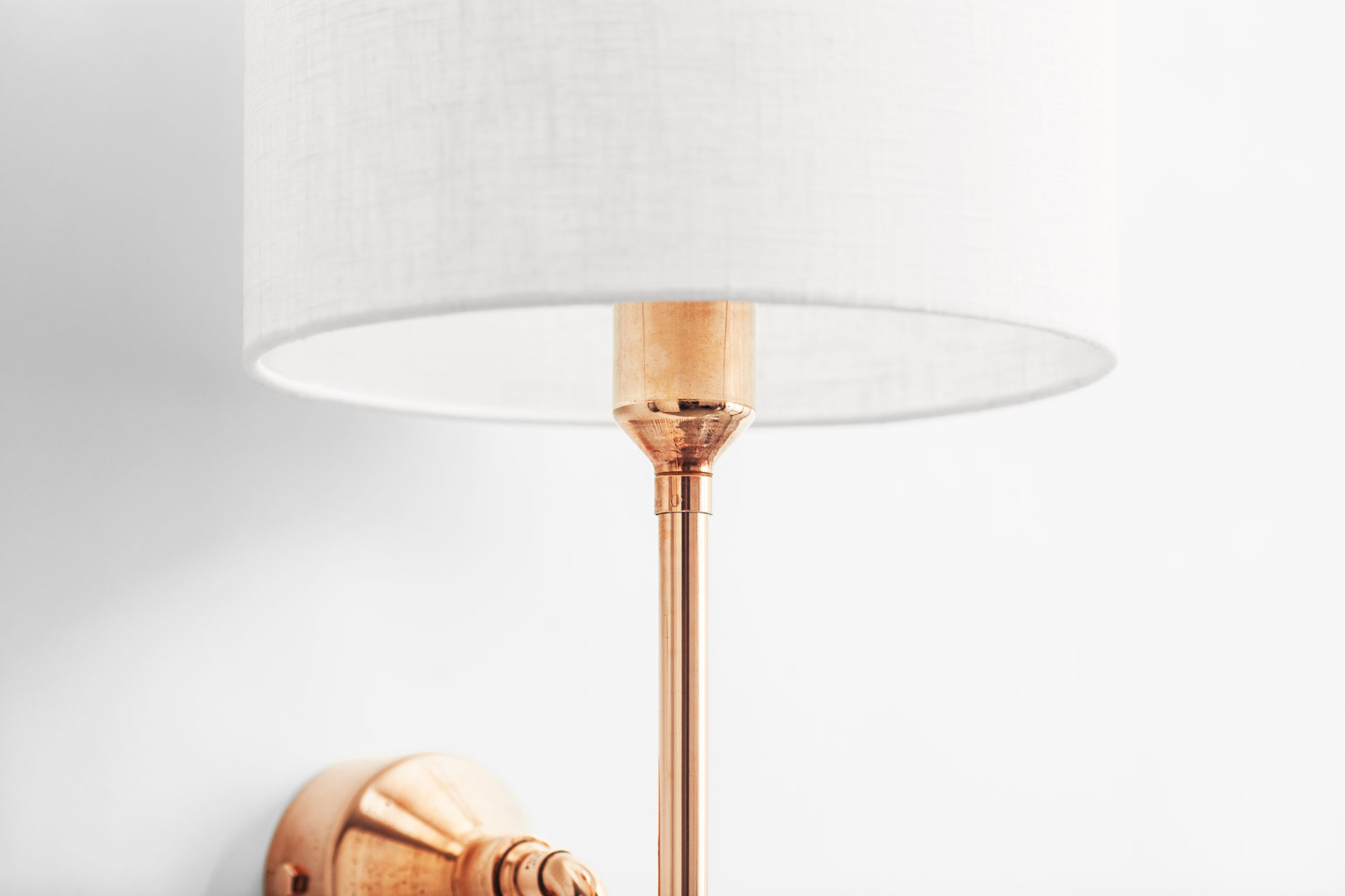 Contemporary design copper wall lamp with white linen shade