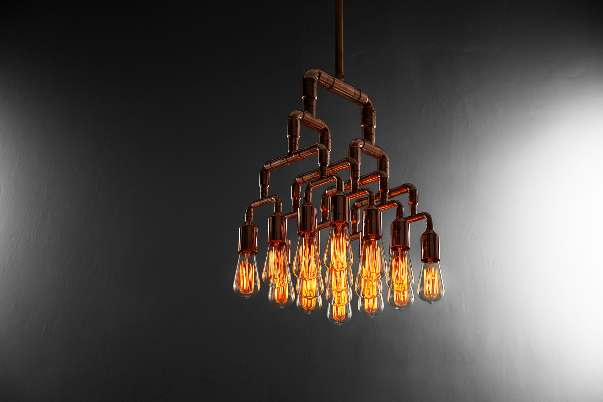 Unique cyberpunk ceiling lamp in trendy copper or brass inspired by industrial design