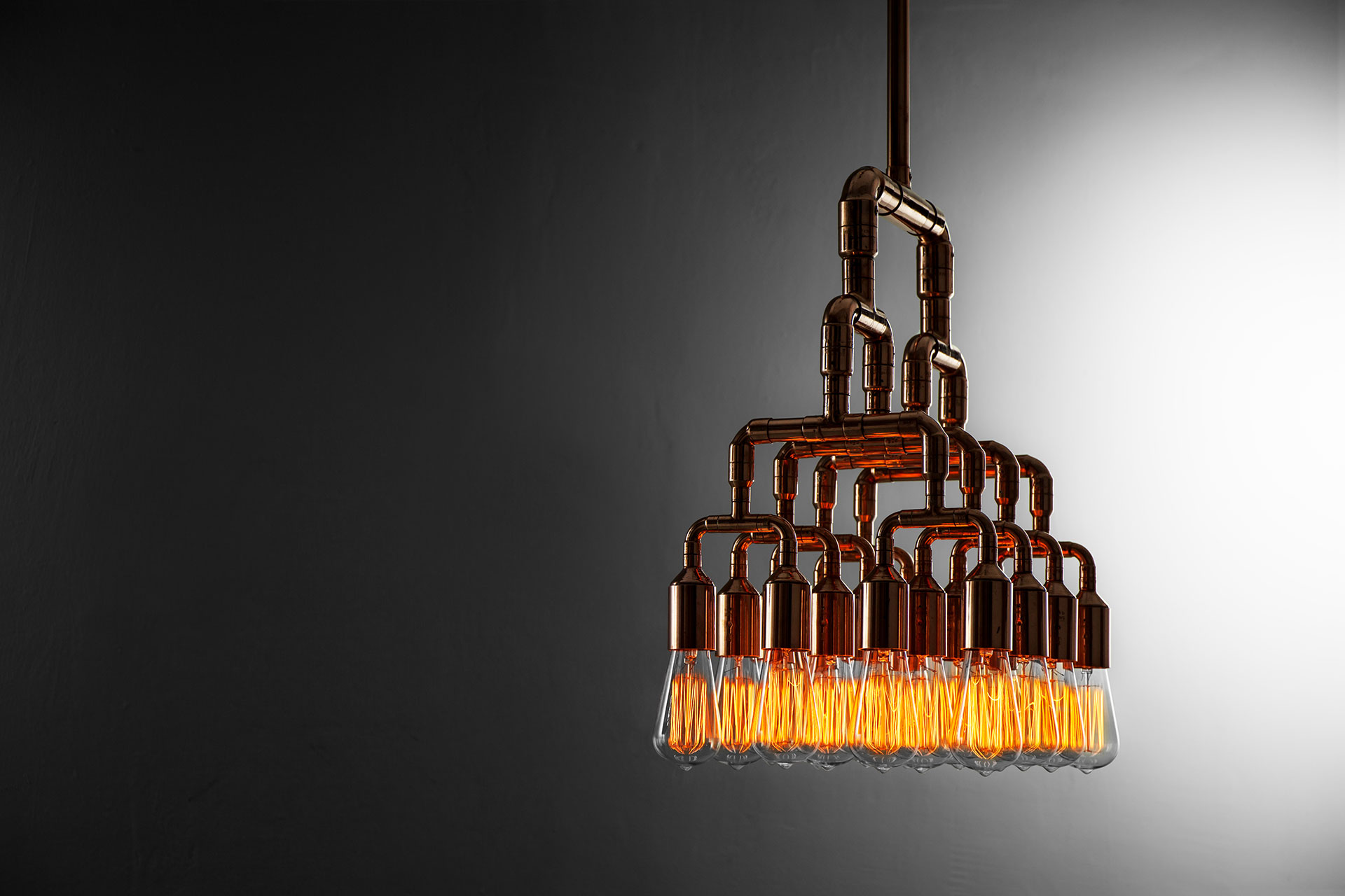 Large decorative ceiling lamp made of trendy copper or brass in loft style interior