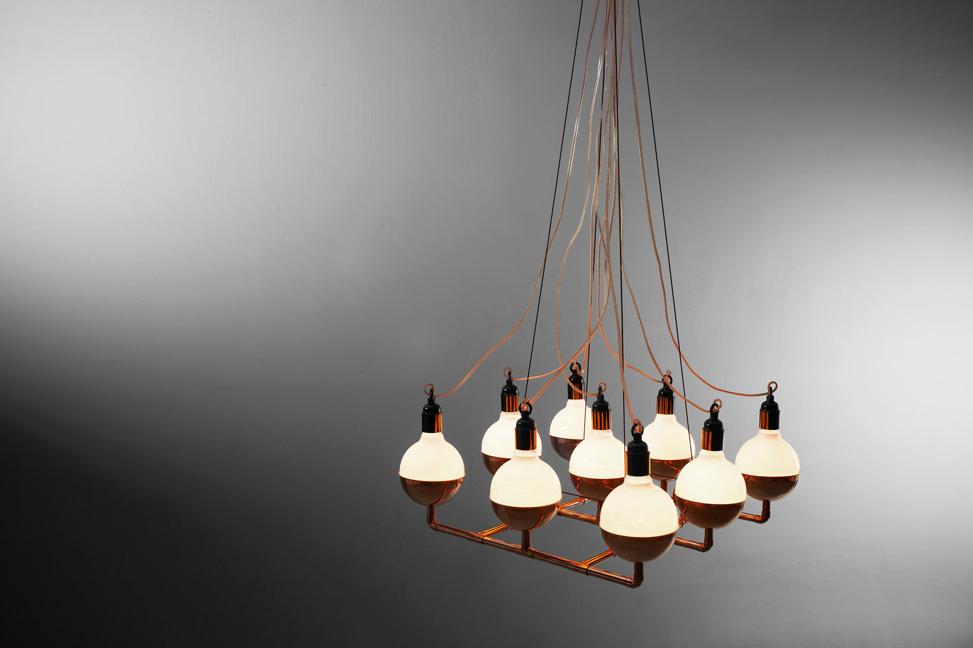 Designer lighting chandelier in trendy copper or brass inspired by cyberpunk style