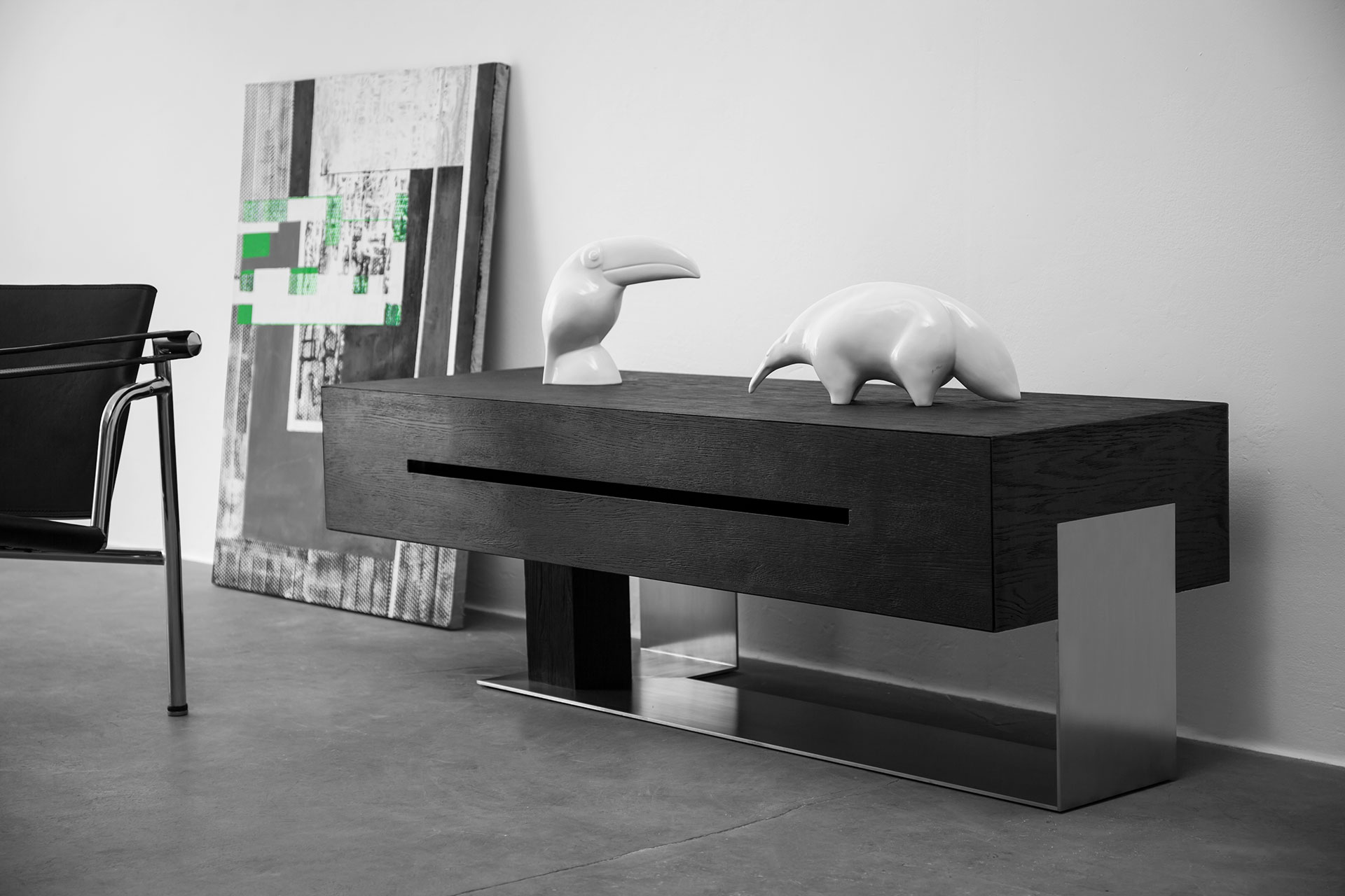 Black wood media console in modern apartment