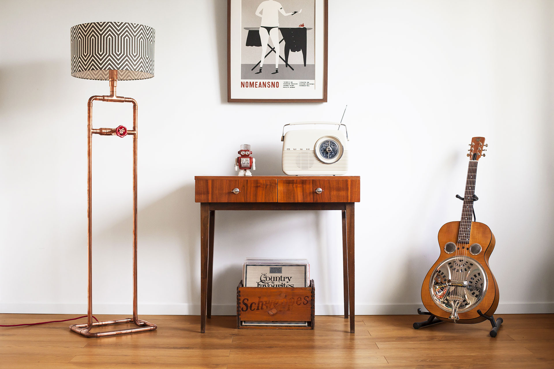 Cool dimmable copper pipe floor lamp with custom geometric shade in vintage modern apartment