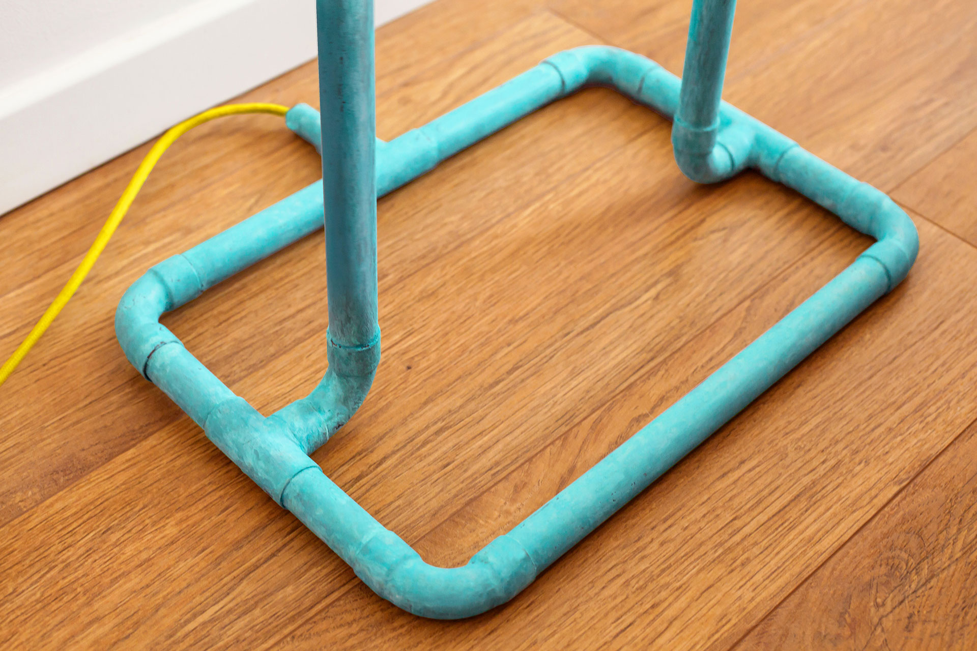 Colorful design floor lamp in turquoise patina with yellow braided cord