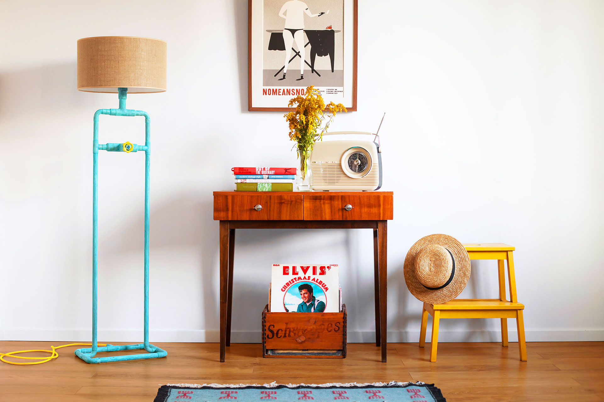 Industrial design floor lamp in trendy turquoise patina with jute shade in colorful hip apartment