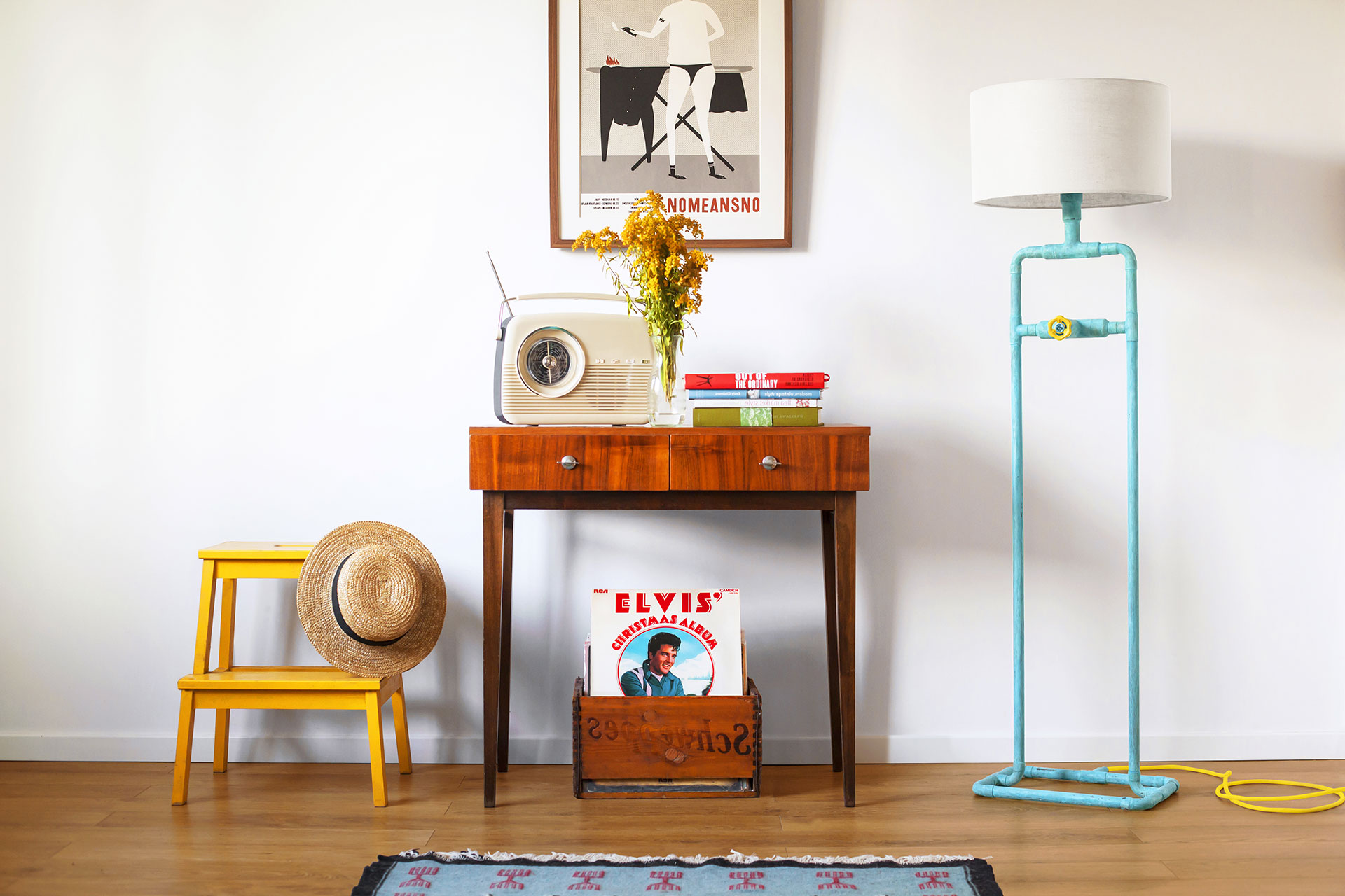 Loft style floor lamp in trendy turquoise patina with white linen shade in colorful chic apartment