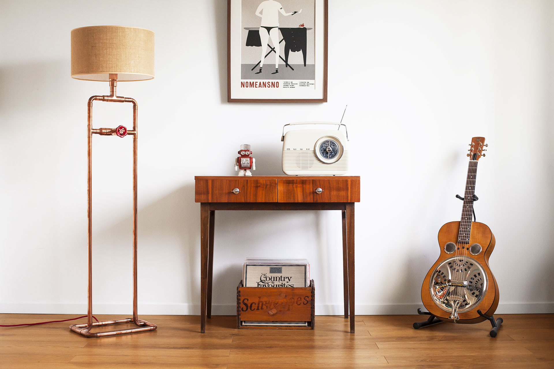 Cozy floor lamp in trendy copper or gold brass with jute shade in vintage modern apartment