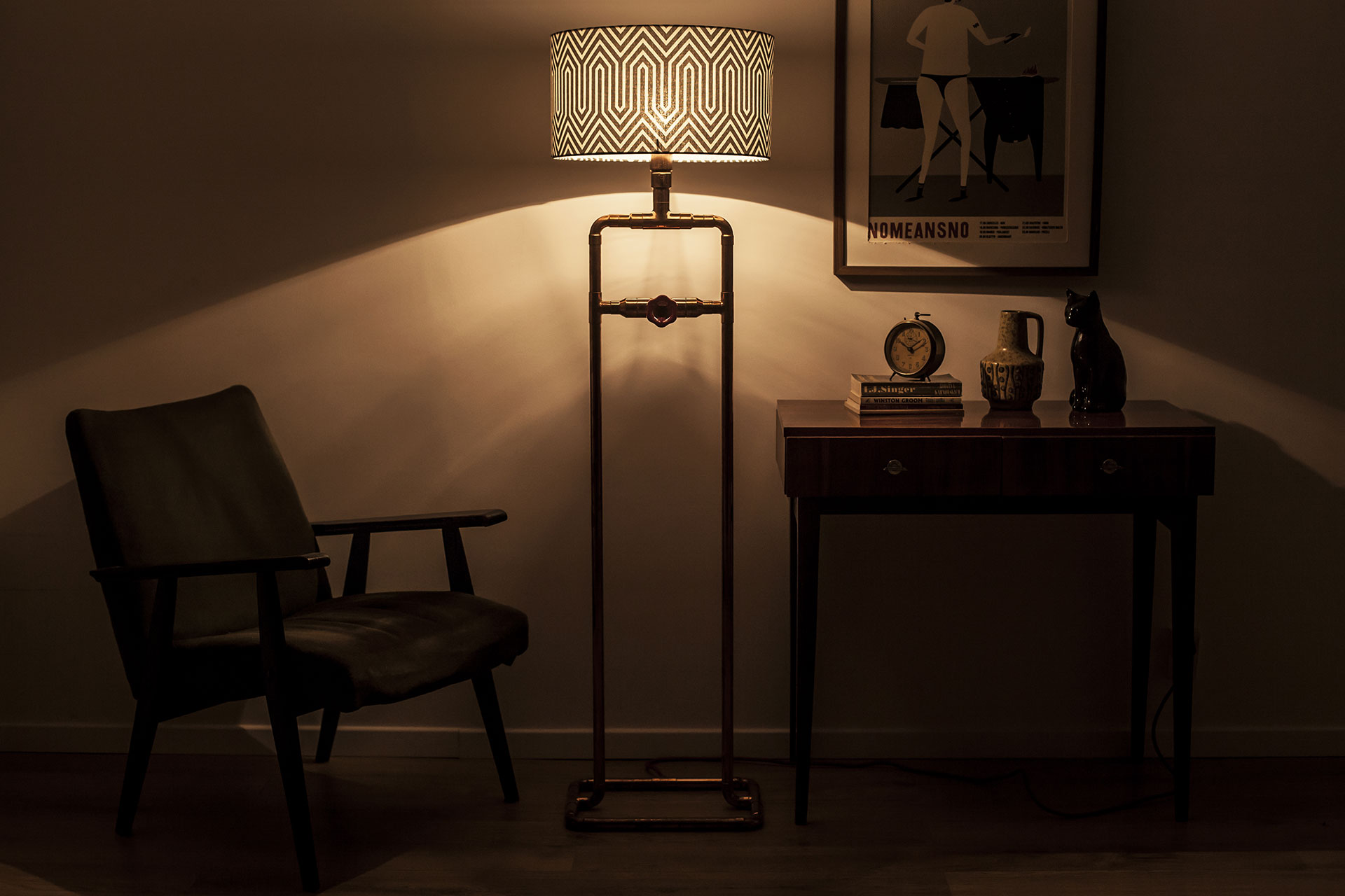 Decorative floor lamp with dimmer and custom geometric shade in vintage hip apartment