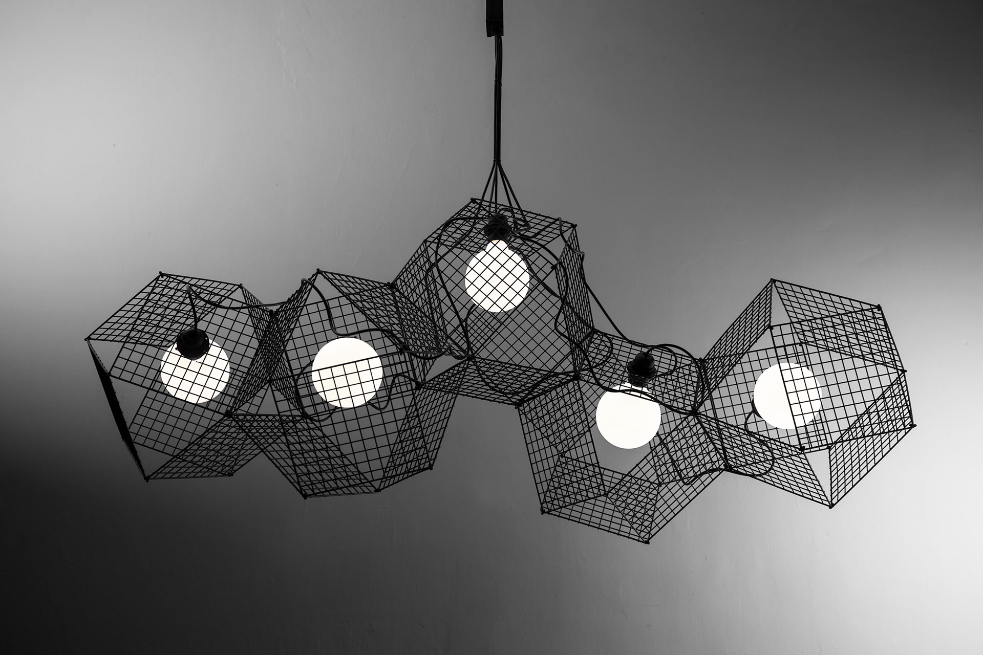 Designer lighting chandelier in modern geometric shape grido by large designer lighting chandelier in black metal inspired by geometric forms mozeypictures Image collections