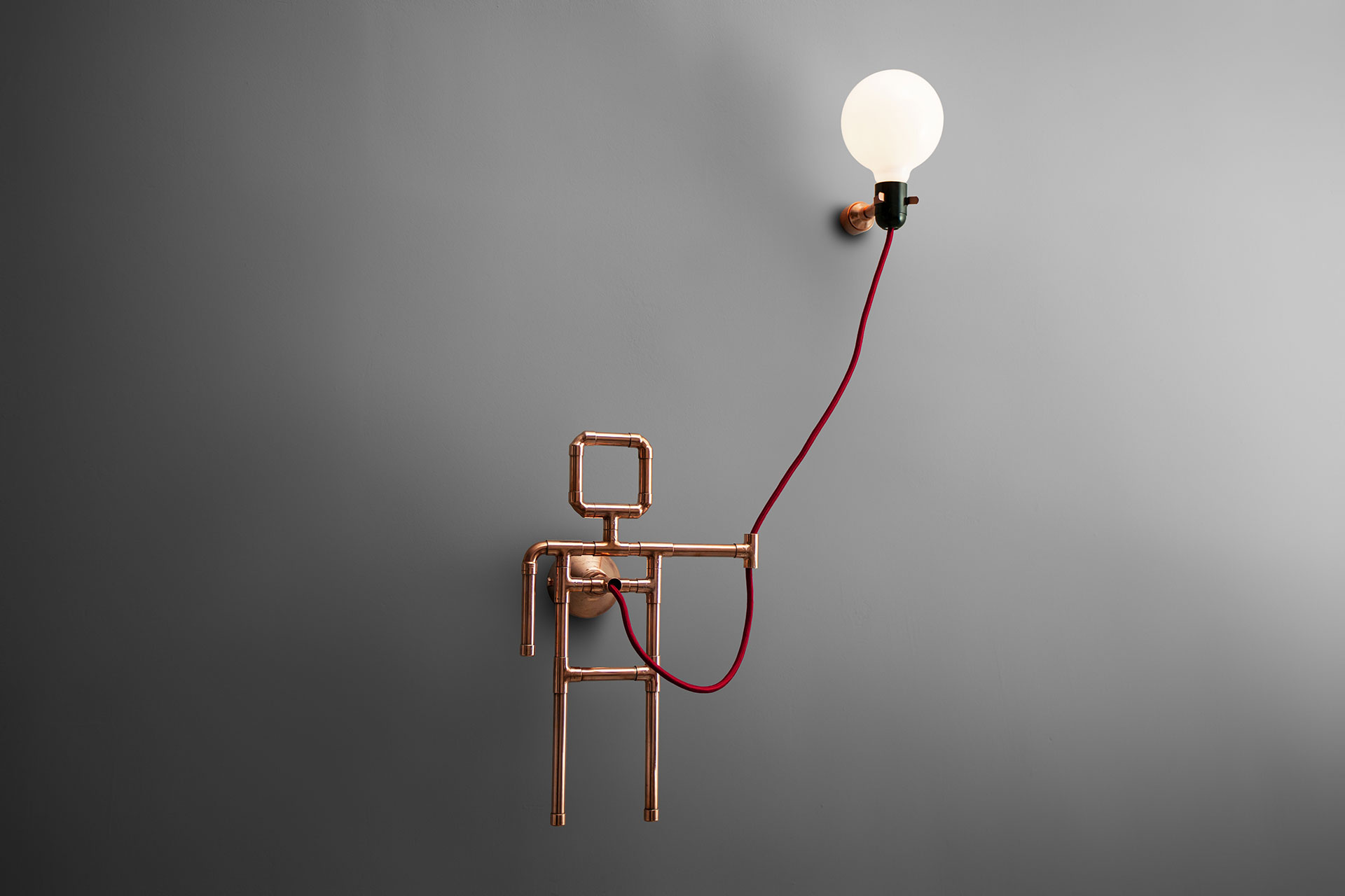 Pipe guy with balloon trendy sconce inspired by industrial design